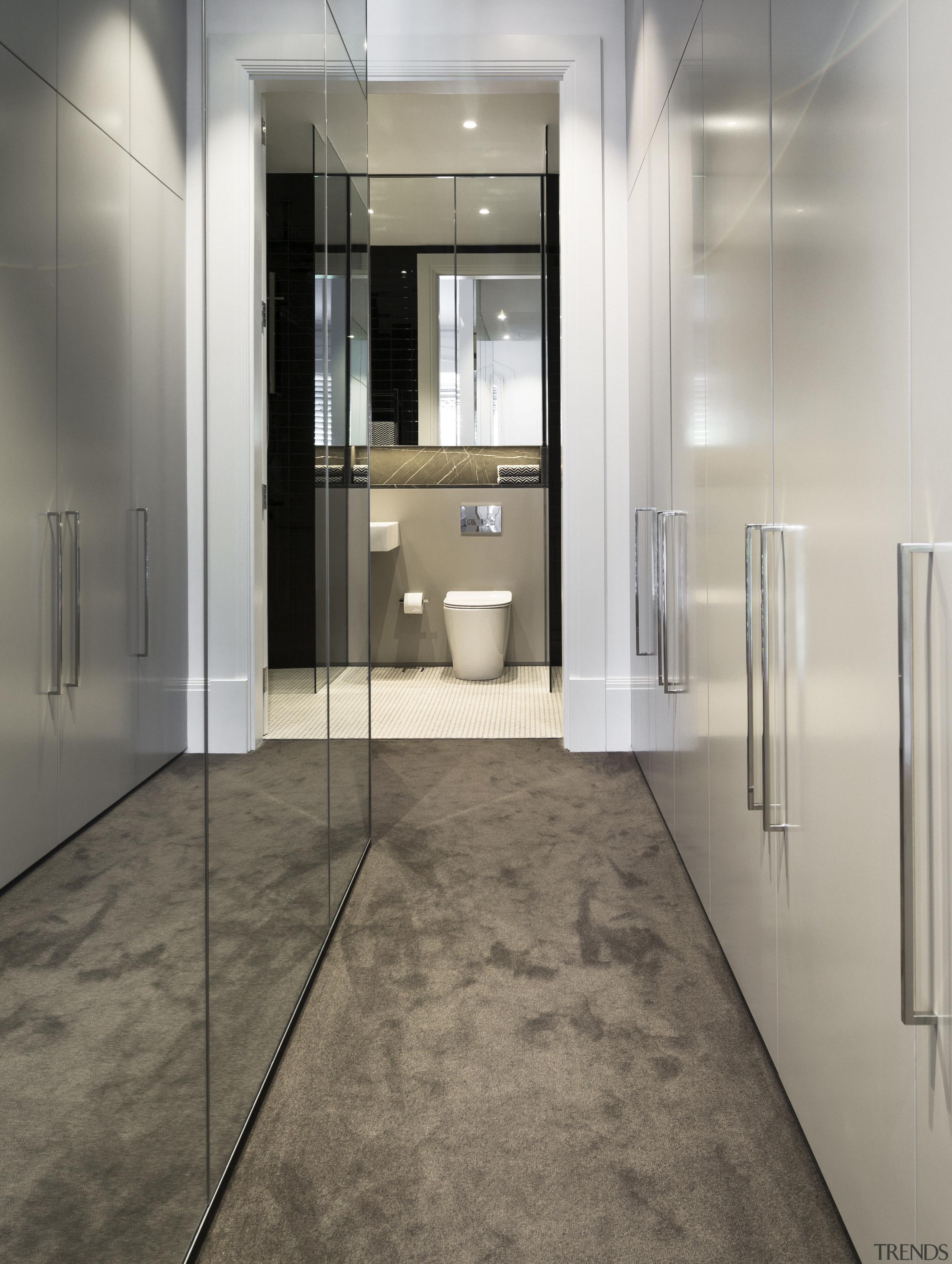 This design optimises space with cupboards built into floor, flooring, interior design, laminate flooring, tile, wood flooring, gray