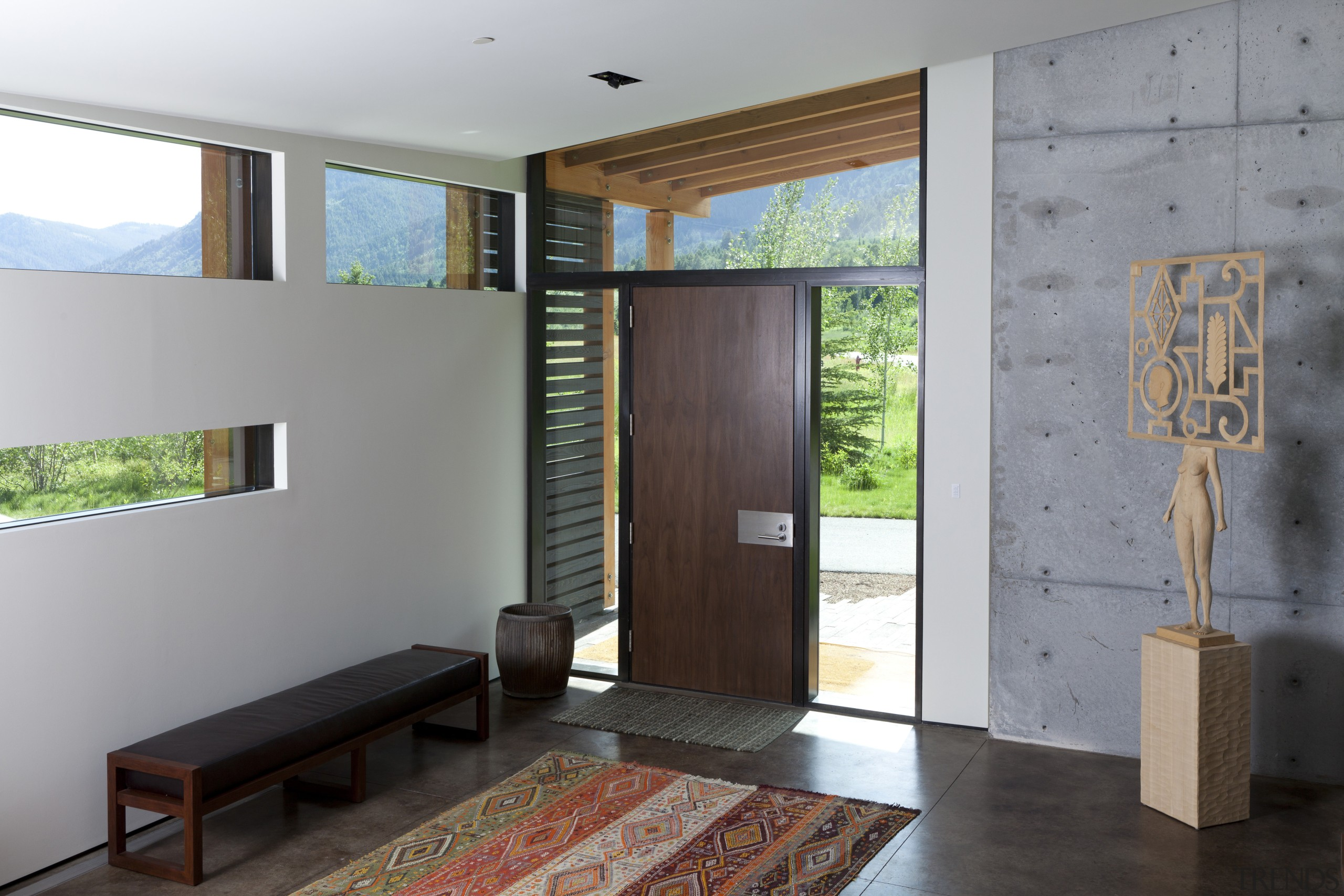 The entry to this mountain home  by architecture, ceiling, door, floor, house, interior design, wall, gray