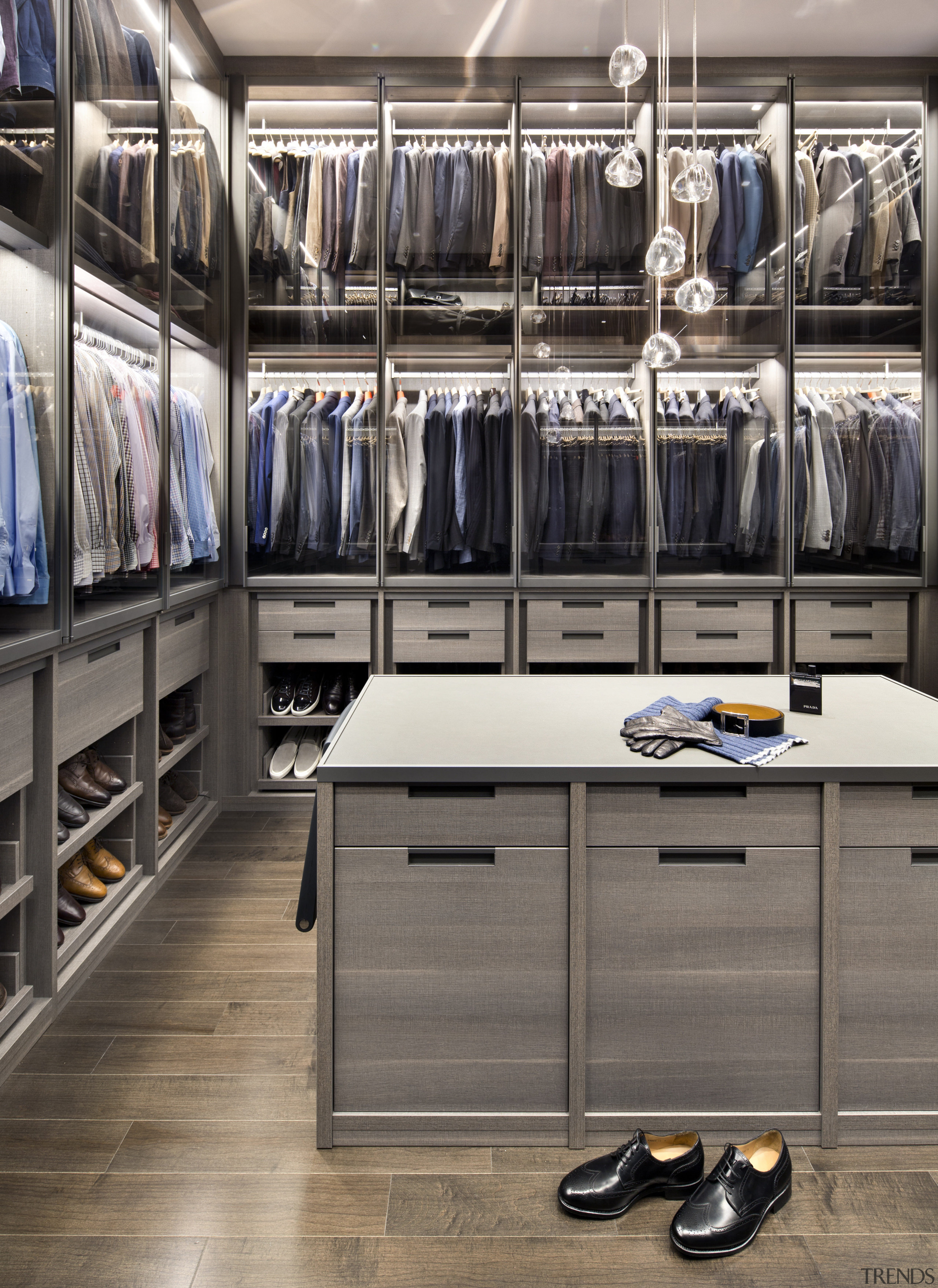 This walk-in wardrobe, and a seasonal closet nearby, closet, countertop, kitchen, room, gray, black