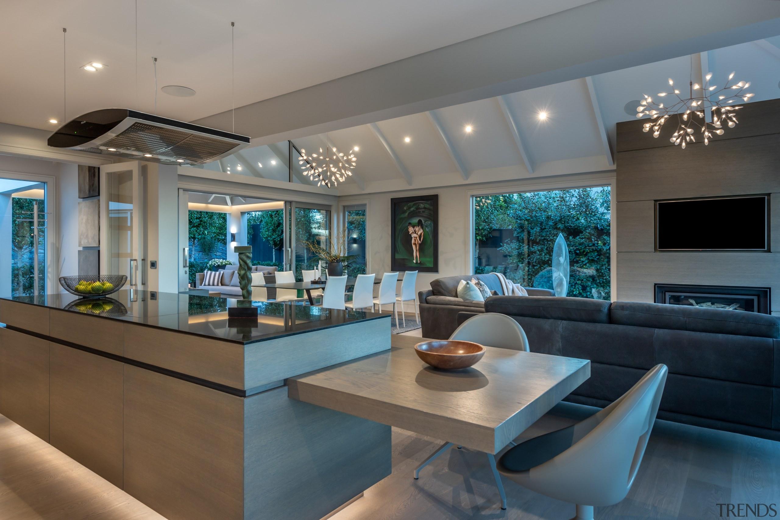 Sculptural, star-burst lighting pendants in this living space