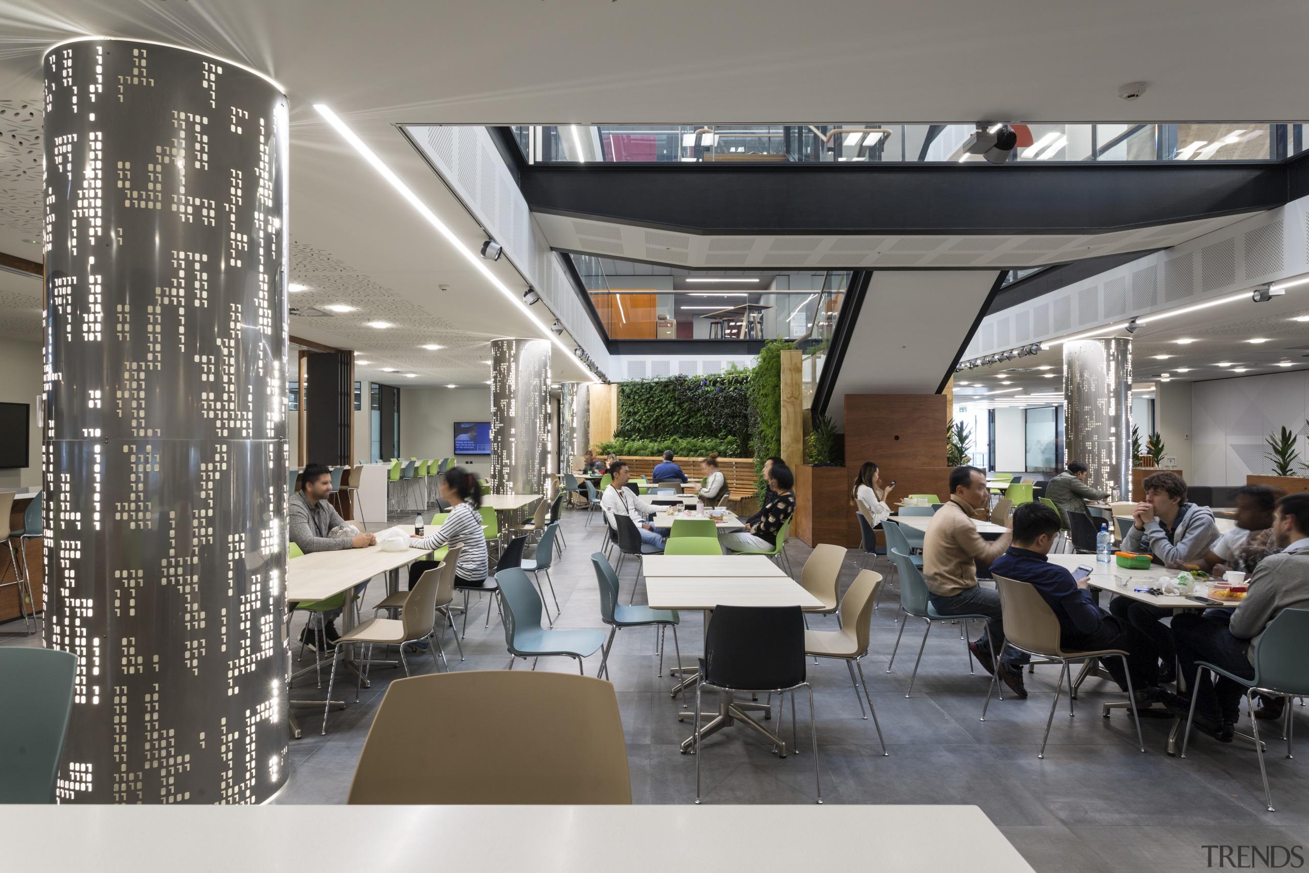 The soaring light-filled atrium of the Datacom building interior design, restaurant, gray