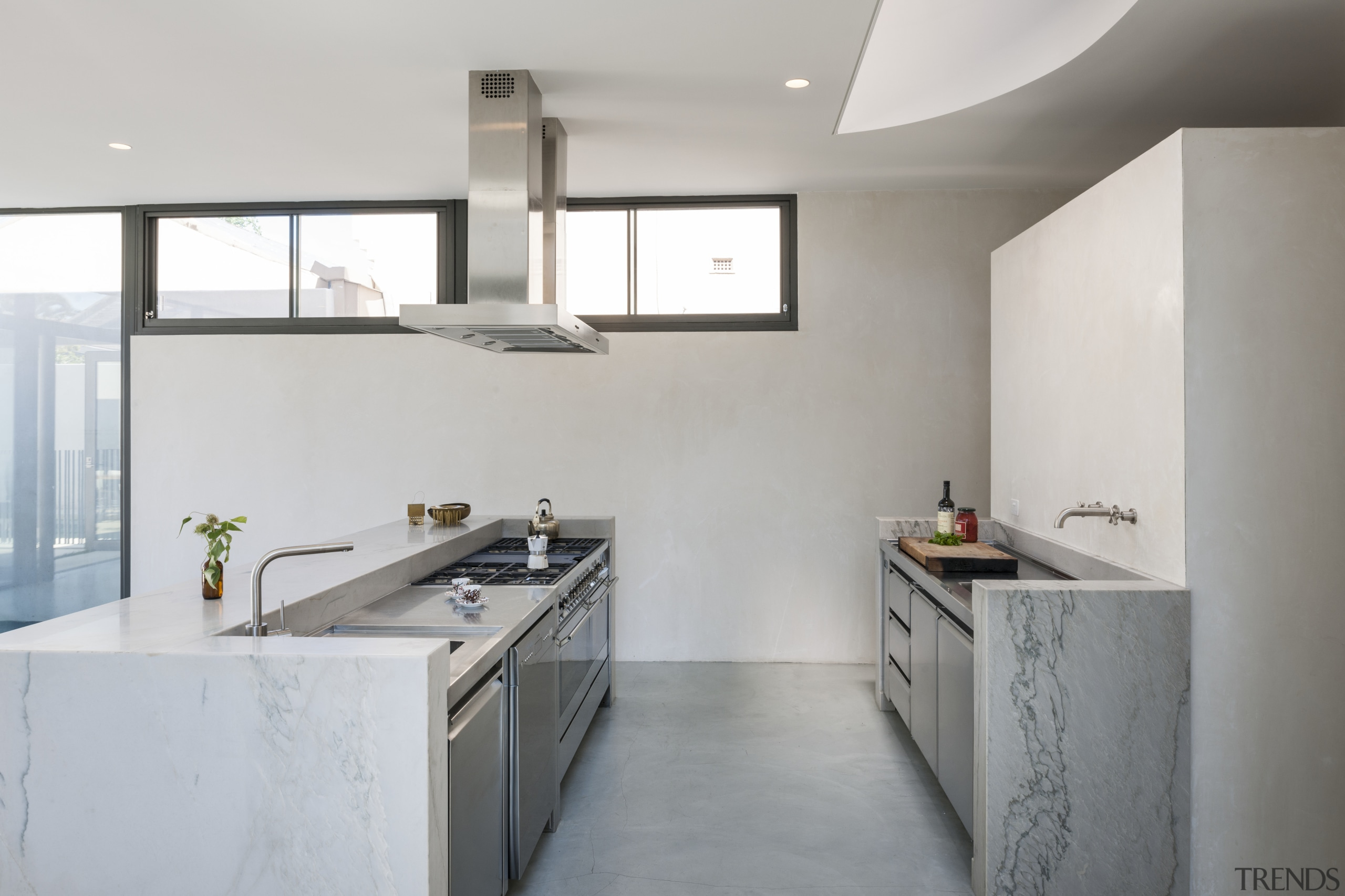 A curved skylight above this new kitchen echoes architecture, bathroom, countertop, floor, home, interior design, kitchen, real estate, room, sink, tap, gray