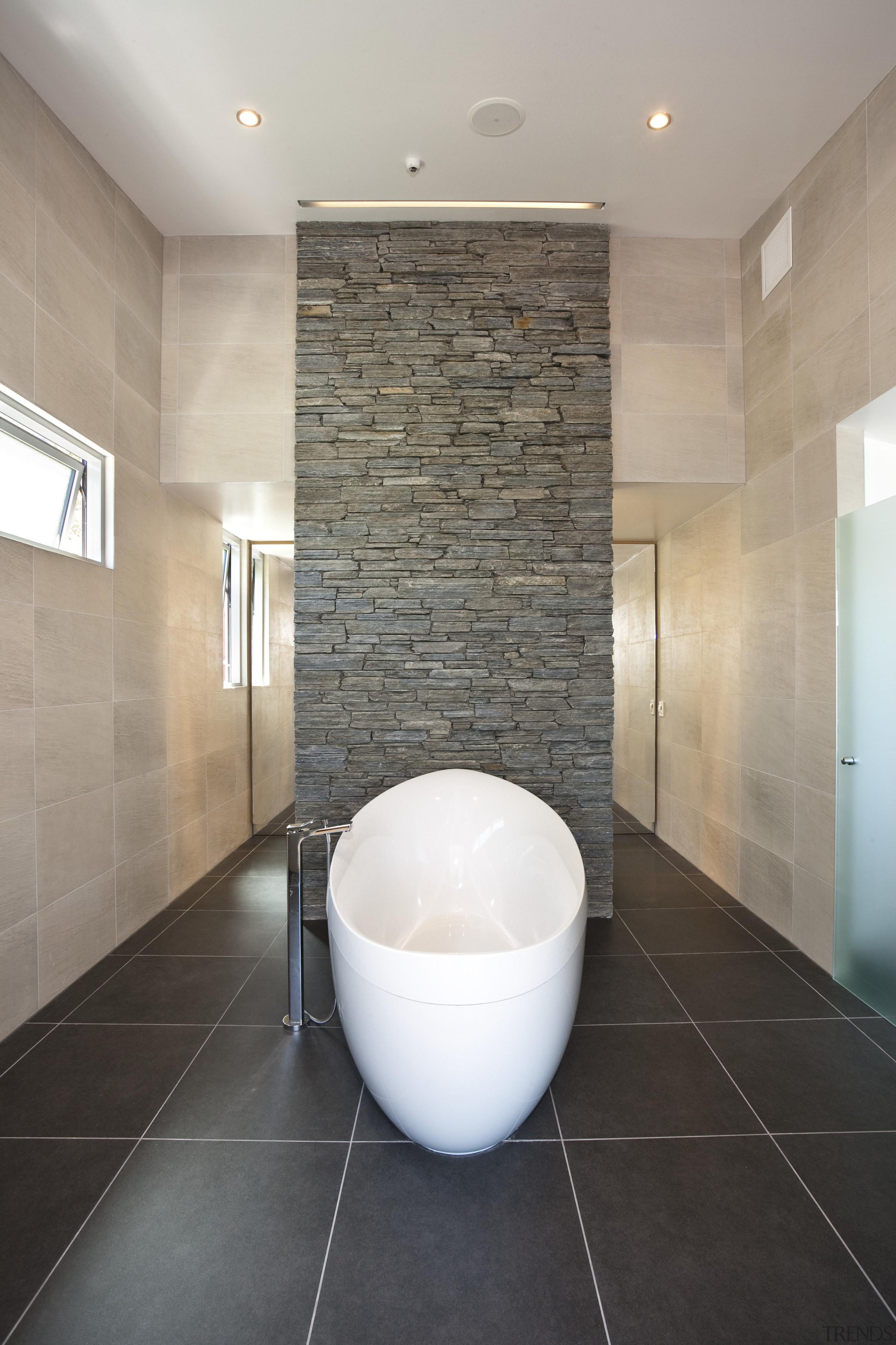 Interior view of this contemporary bathroom - Interior architecture, bathroom, ceiling, ceramic, daylighting, floor, flooring, interior design, plumbing fixture, room, sink, tile, wall, gray