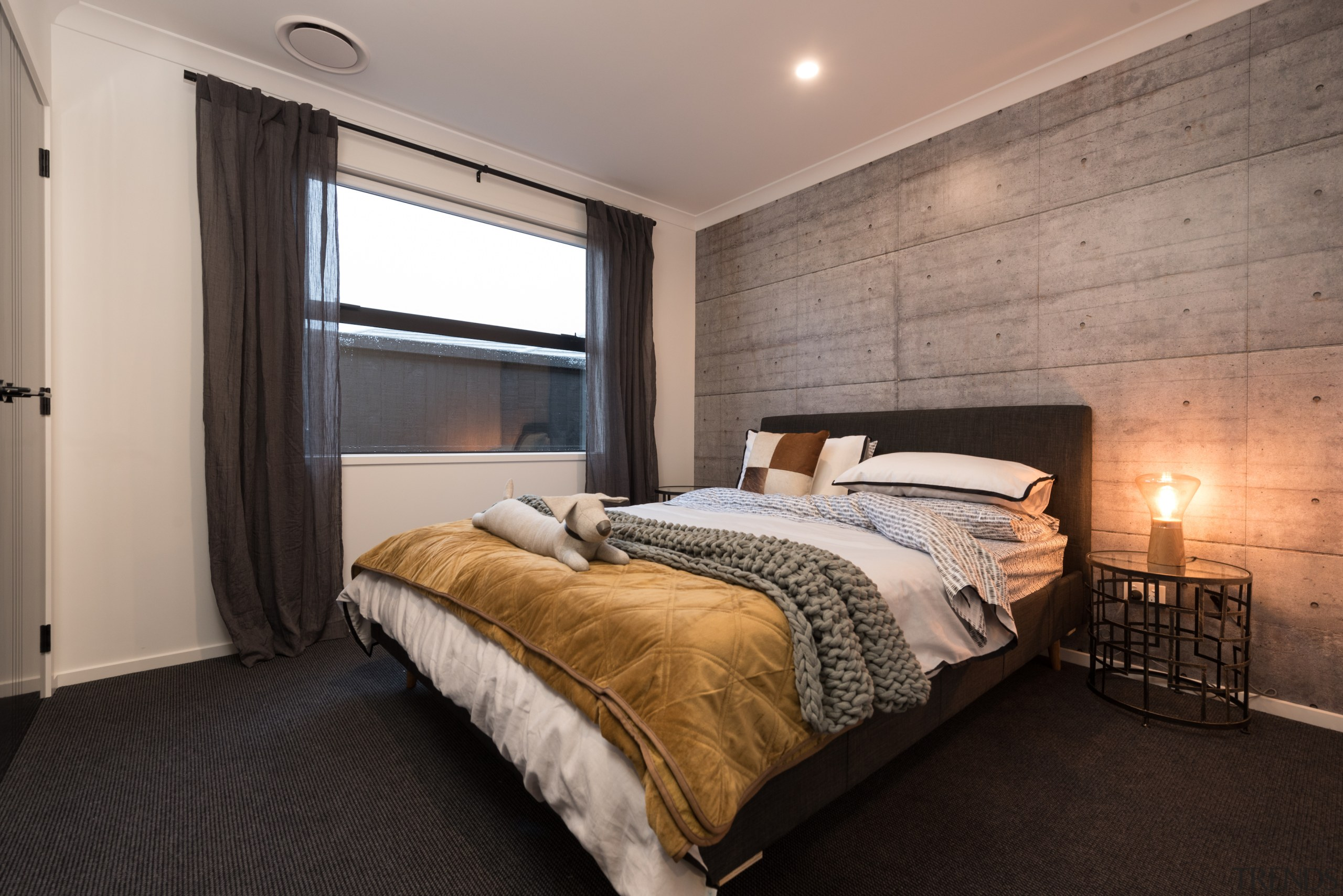 Board formed concrete creates a feature wall with