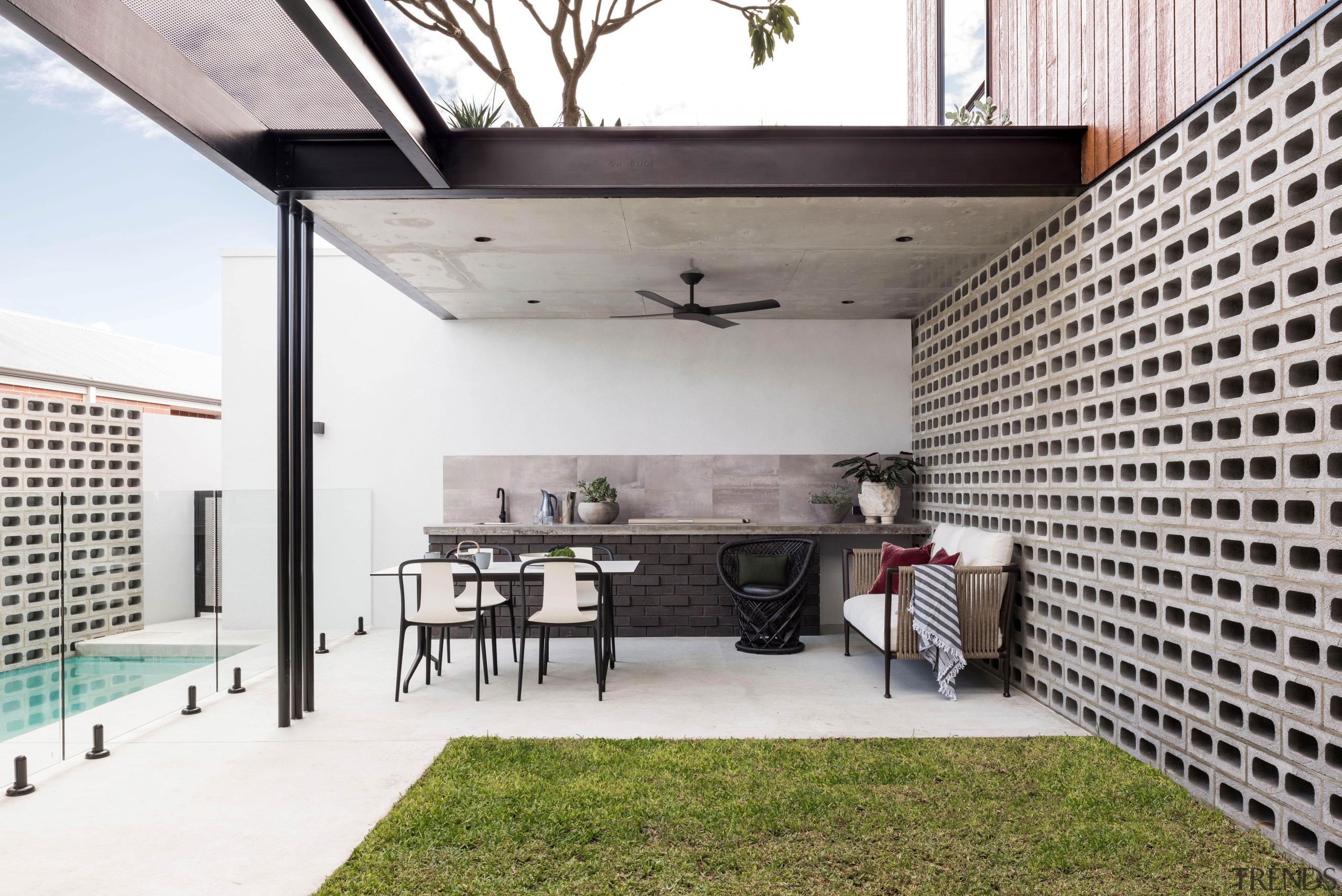 This alfresco dining area features materials such as architecture, alfrsco dining, design, furniture, home, house, interior design