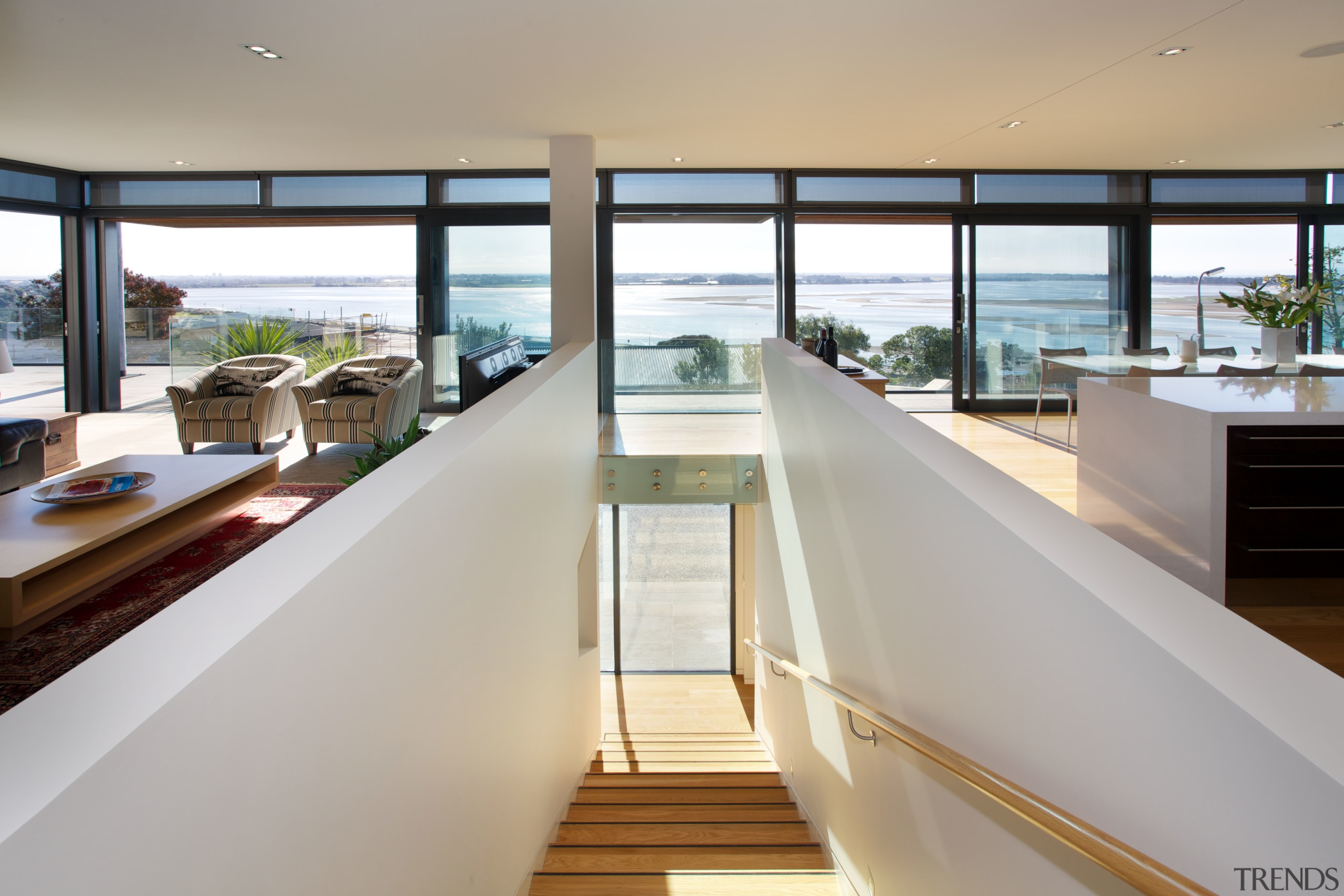 Stairs to the upper level are shielded from apartment, house, interior design, real estate, window, gray