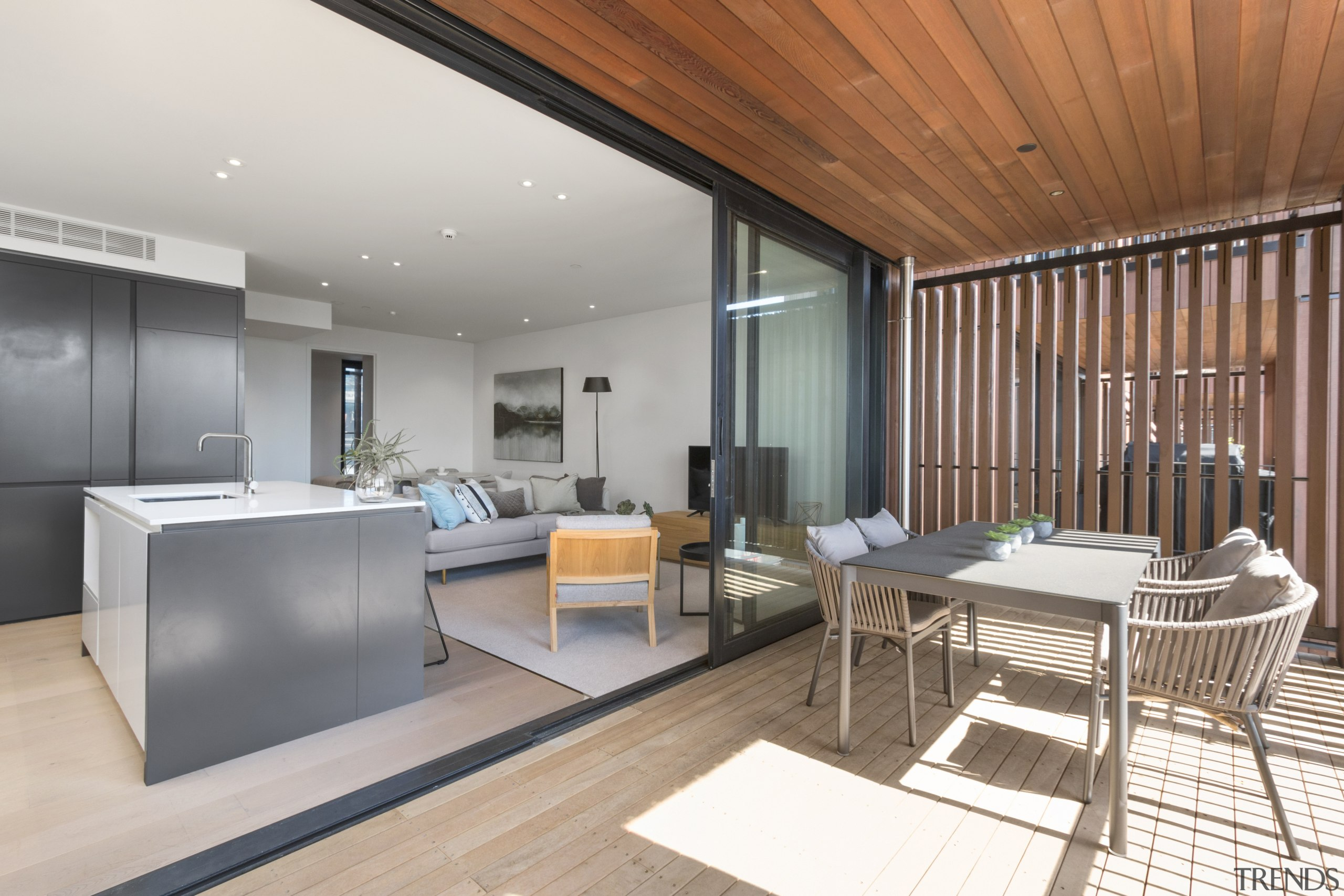 :One of the screened decks in the Pavilion apartment, architecture, building, ceiling, daylighting, design, floor, flooring, furniture, hardwood, home, house, interior design, living room, loft, office, property, real estate, roof, room, table, wall, gray