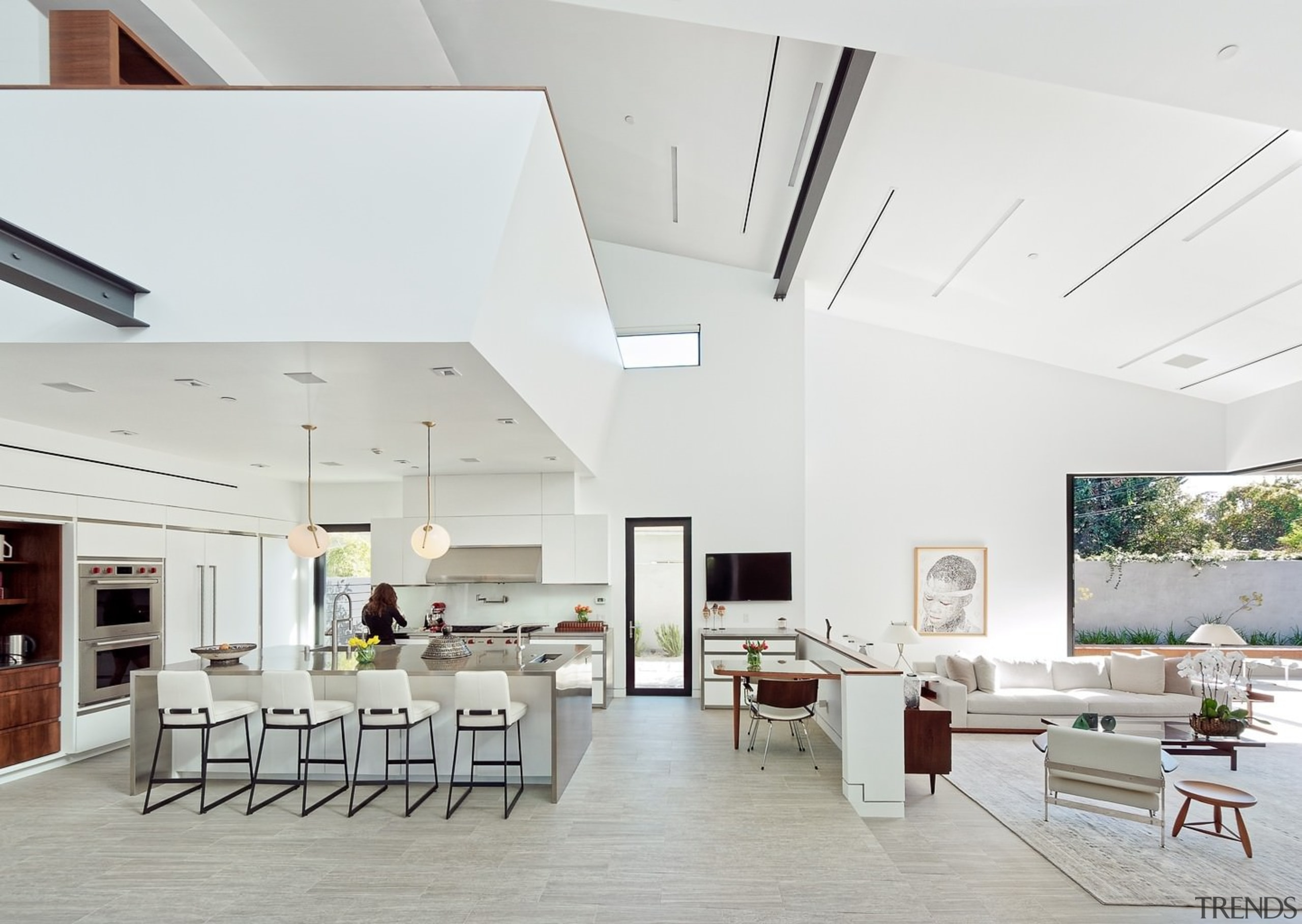The cavernous living area wraps around a large architecture, ceiling, daylighting, house, interior design, living room, real estate, white