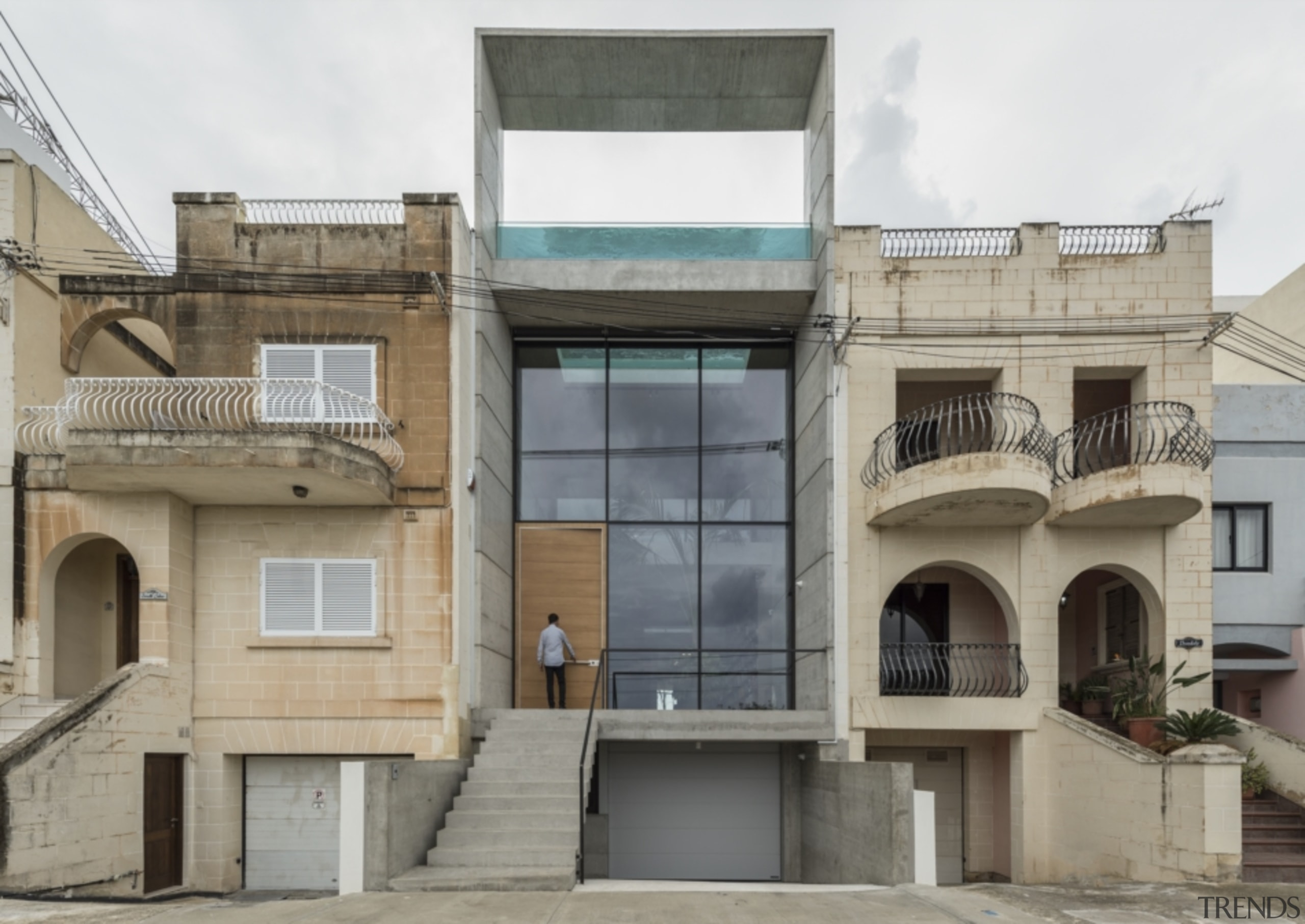 Located in a neighbourhood formed by traditional buildings, apartment, architecture, balcony, building, facade, home, house, material property, neighbourhood, property, real estate, residential area, urban area, urban design, window, gray, pool, rooftop pool