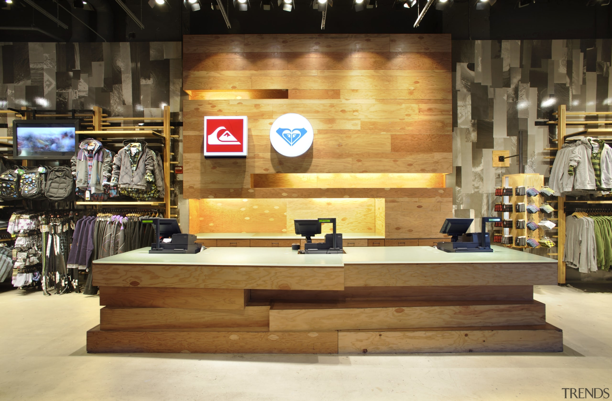 Interior view of the Quicksilver store in New furniture, wood, orange, brown