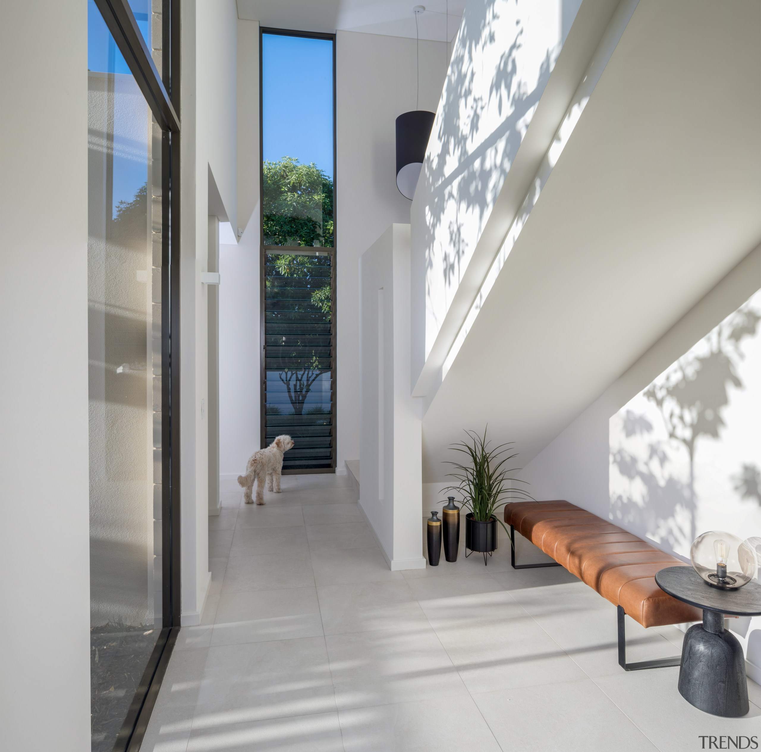 Contemporary, well-connected home opens up to backyard and aluminium, architecture, building, ceiling, daylighting, door, floor, flooring, furniture, glass, hall, home, house, interior design, loft, property, real estate, room, tile, white, window, gray