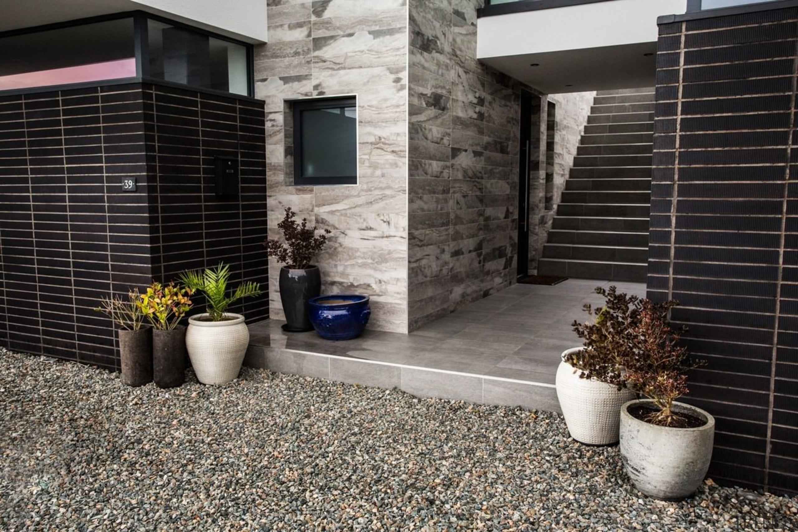 Architect: 2020 ArchitectsPhotography by Reinis Babrovskis courtyard, facade, floor, flooring, home, house, property, real estate, siding, walkway, wall, window, black, gray