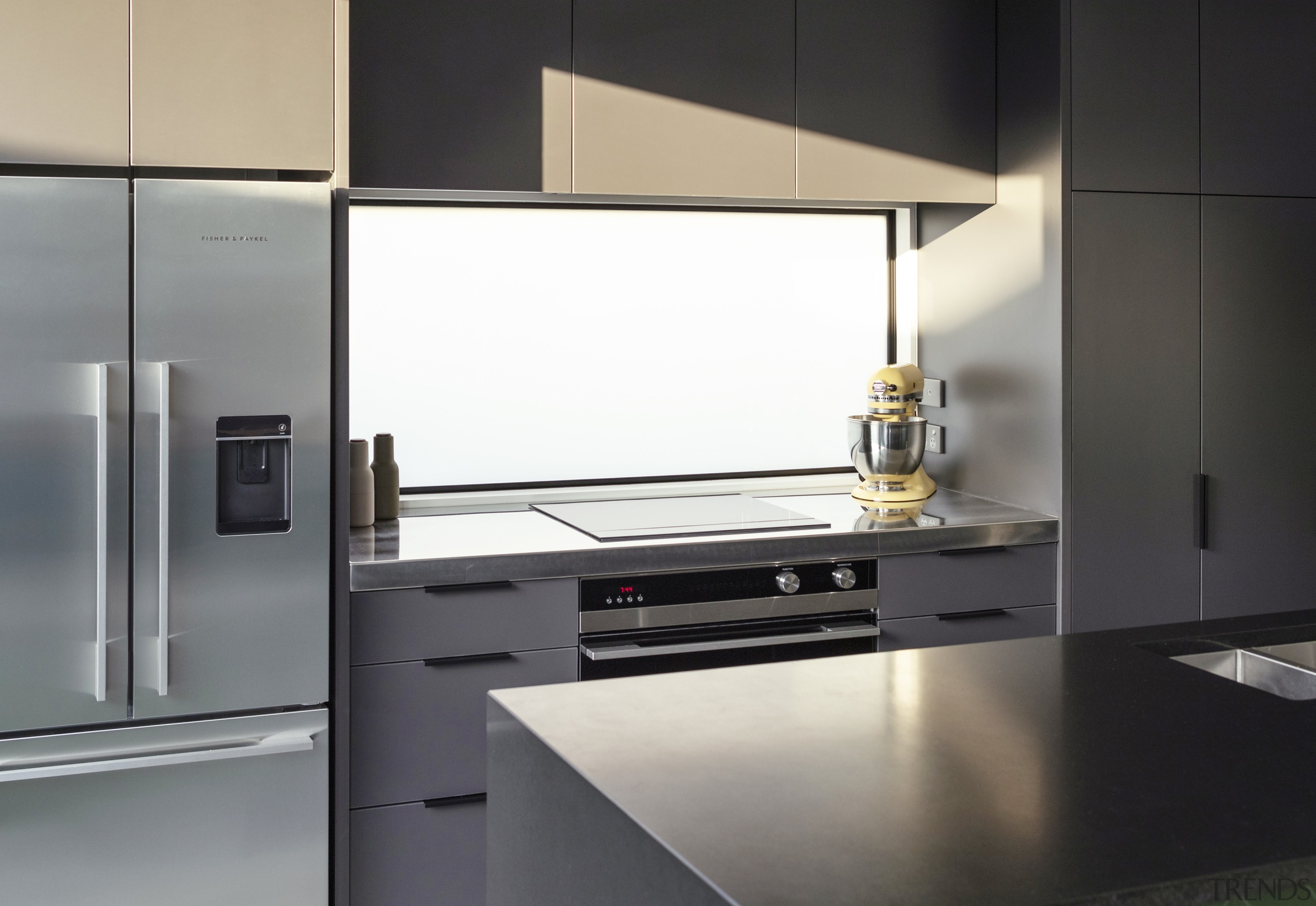A window splashback admits natural light on the