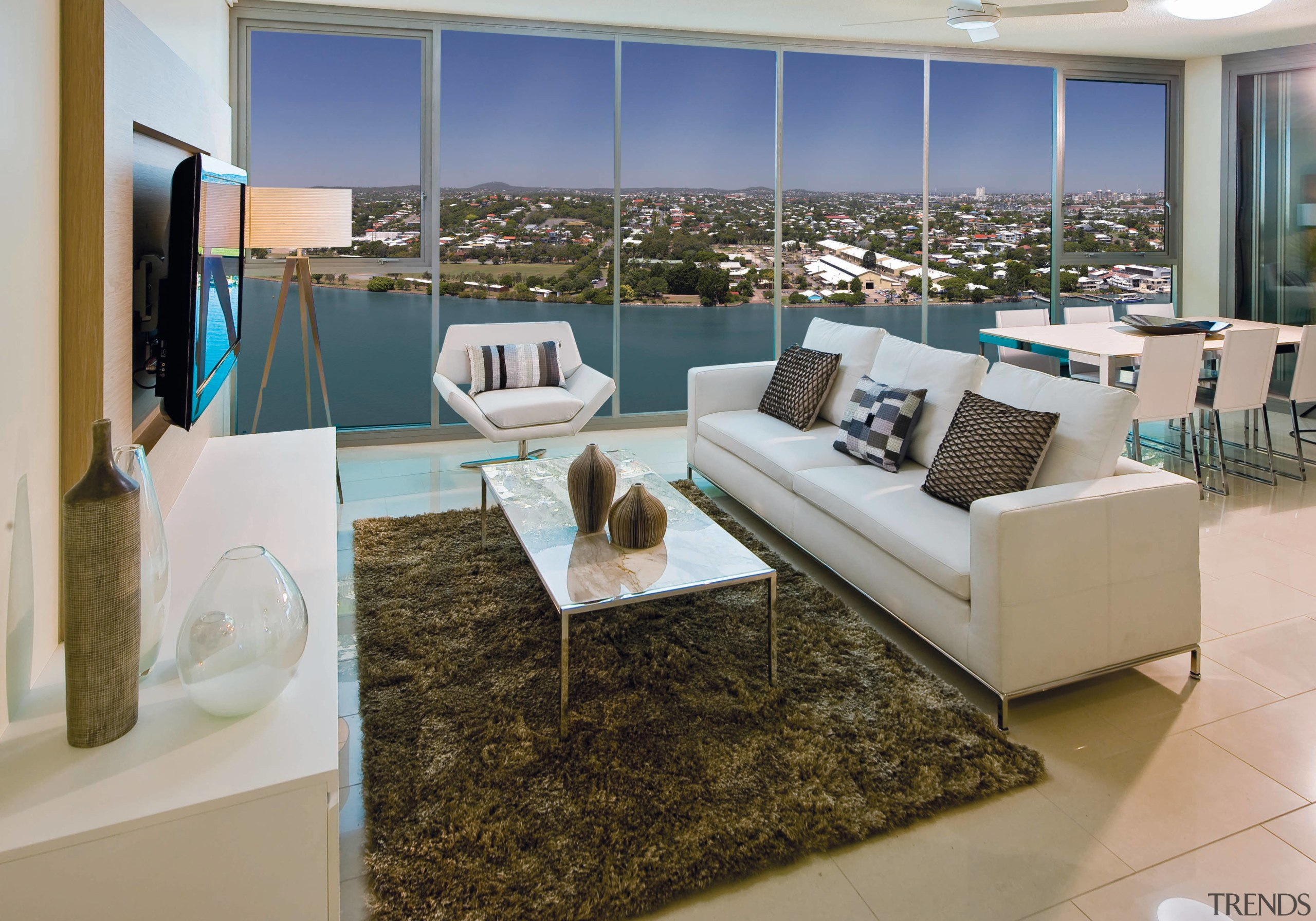 View of Hamilton Harbour apartment open-plan living area floor, furniture, interior design, living room, property, real estate, gray, brown
