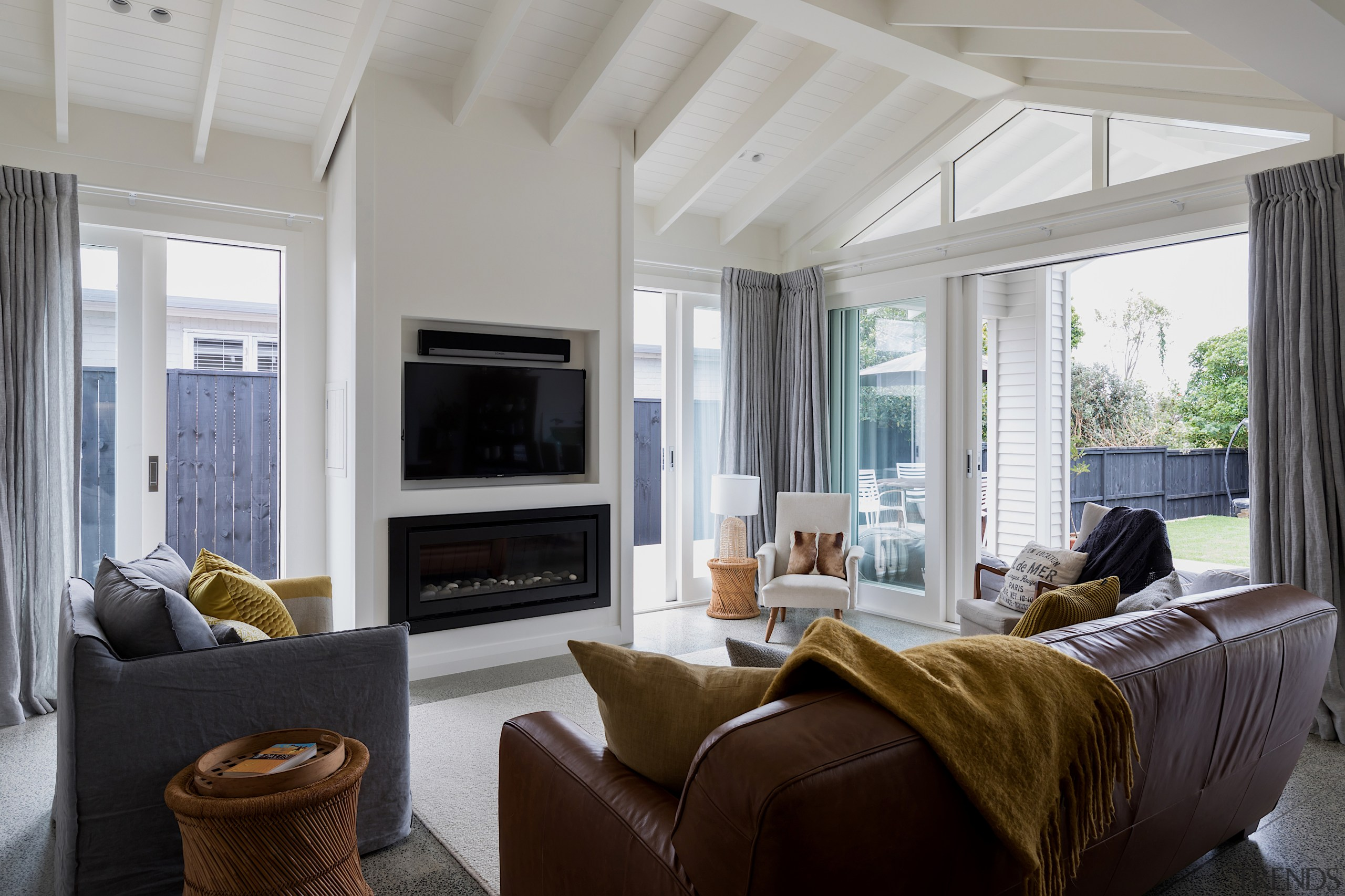 The living area opens to the outdoors on