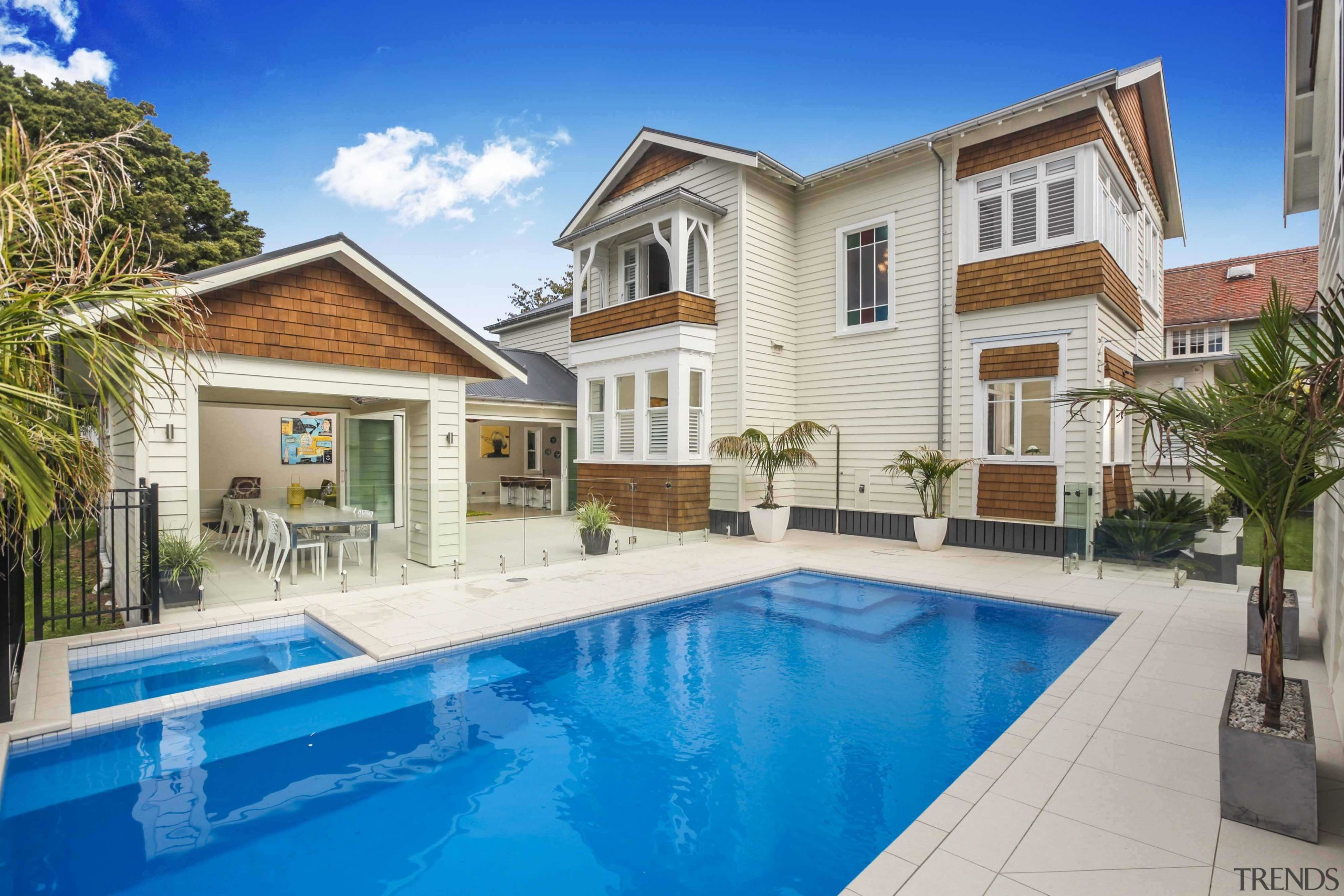 The home certainly doesn't lack for height - apartment, elevation, estate, facade, home, house, mansion, property, real estate, residential area, swimming pool, villa, gray, teal