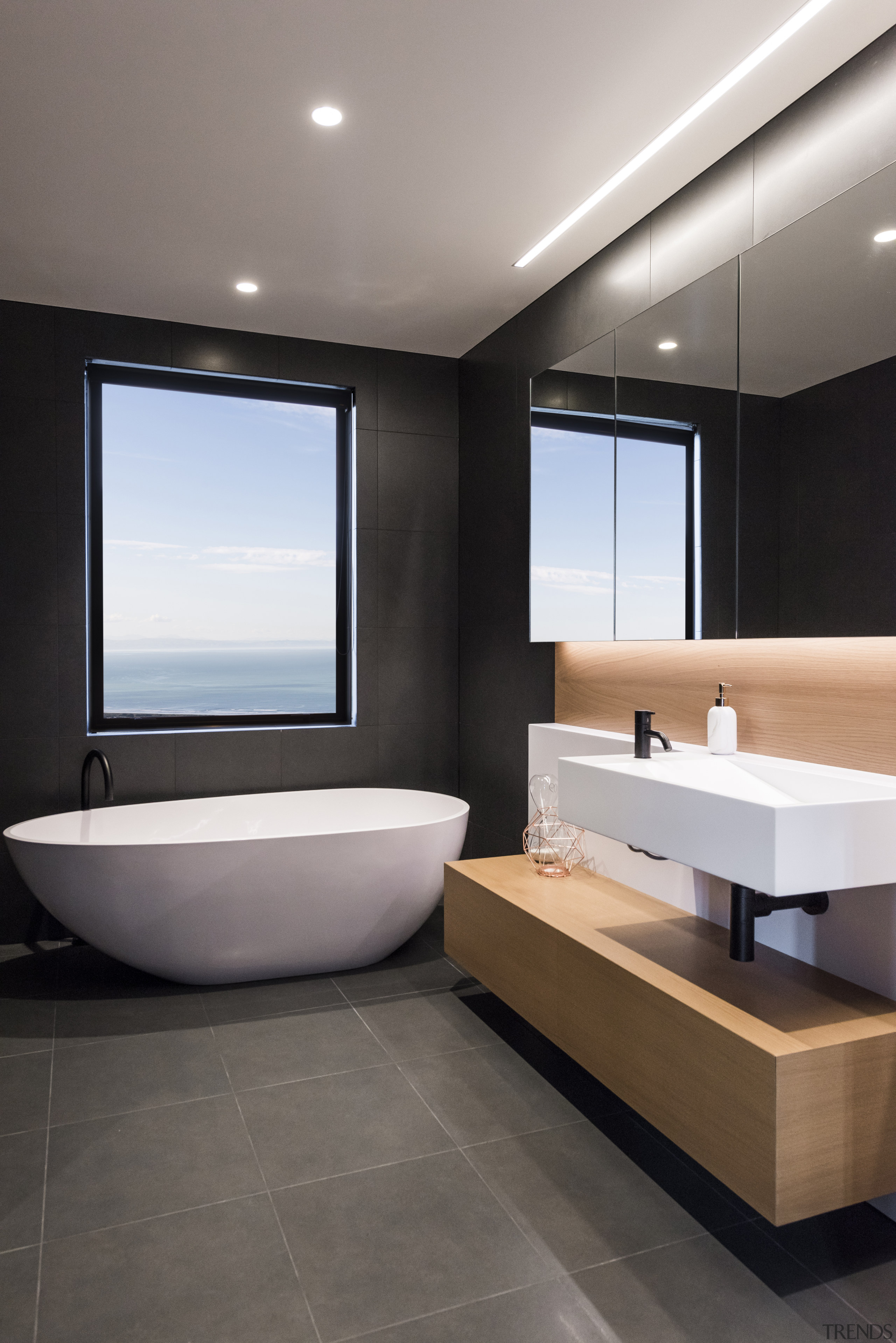 To achieve the effect you want in a bathroom, floor, tiles, interior design, sink, gray, black, freestanding bath, timber vanity top, Davinia Sutton