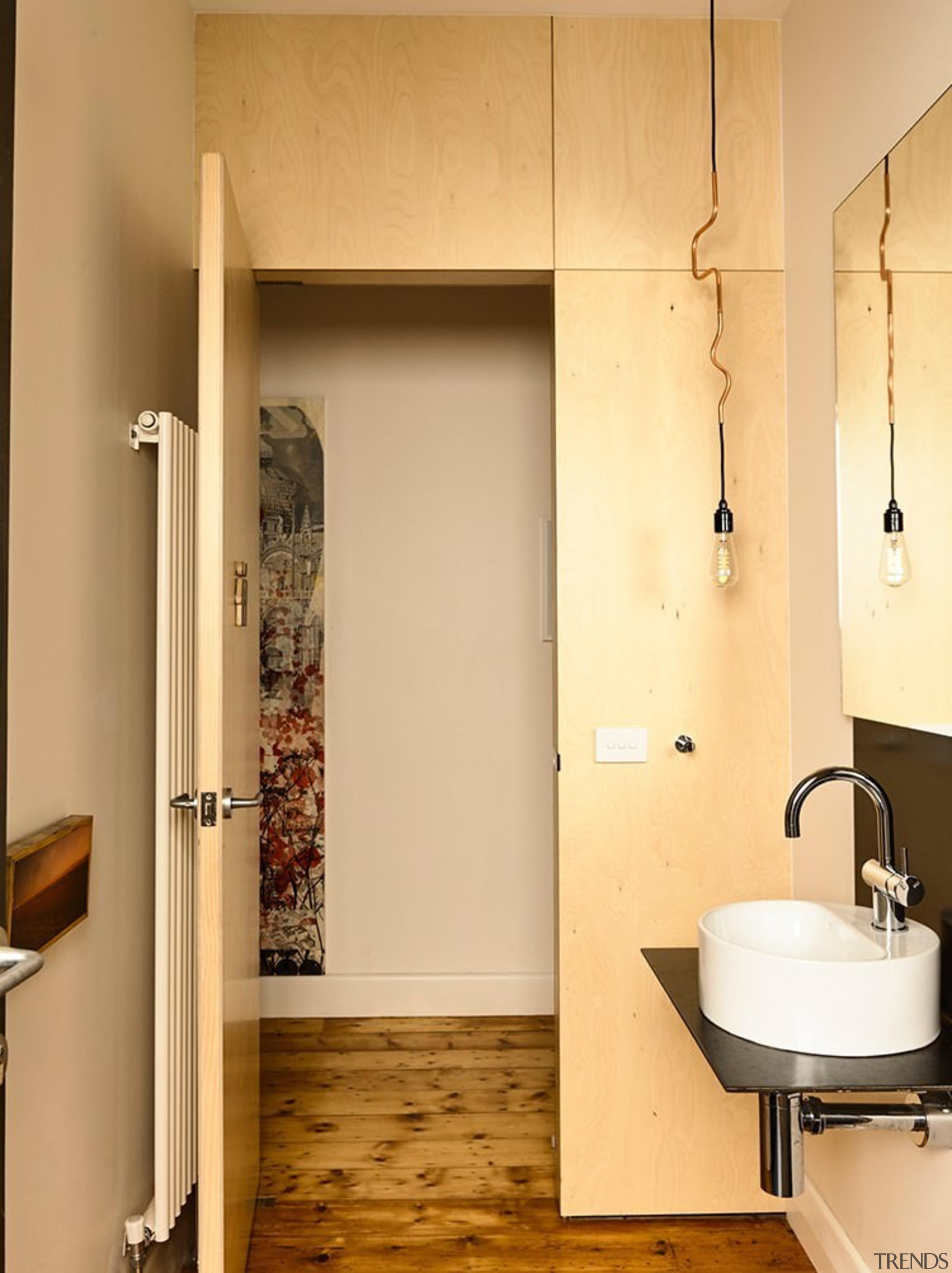 A floating sink makes the bathroom feel larger bathroom, bathroom accessory, bathroom cabinet, ceiling, floor, flooring, interior design, plumbing fixture, room, wall, wood, orange