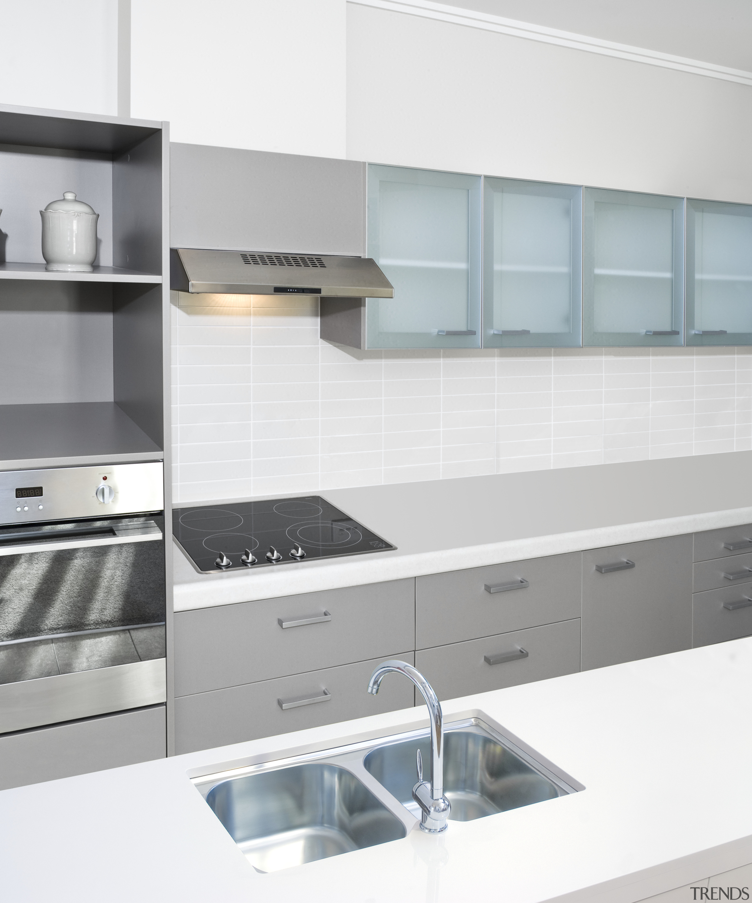 view of a kitchen which features Oliveri's new countertop, kitchen, kitchen stove, product, product design, white, gray