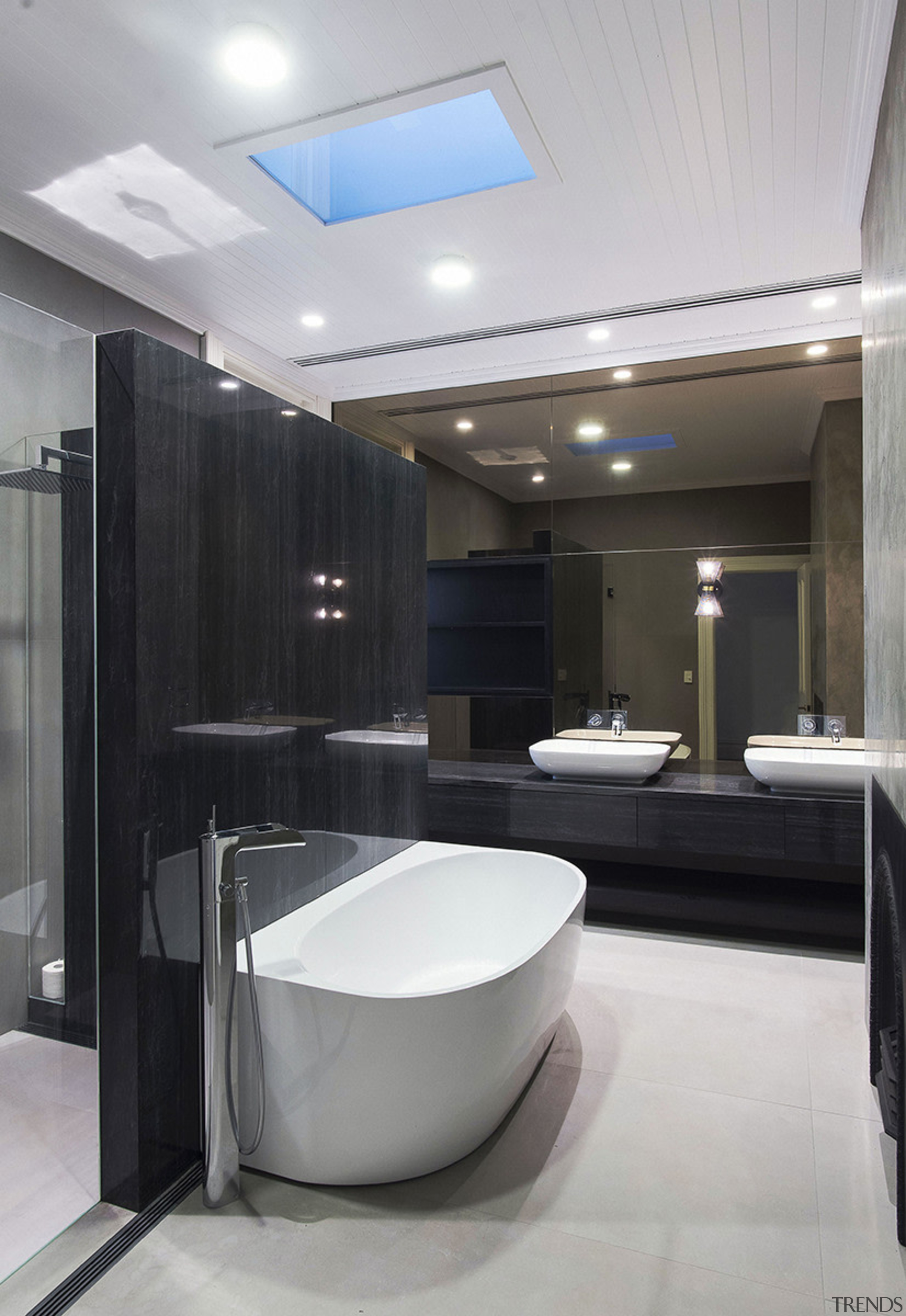 This home's main bathroom – in the original bathroom, floor, interior design, plumbing fixture, room, sink, gray, black, skylight