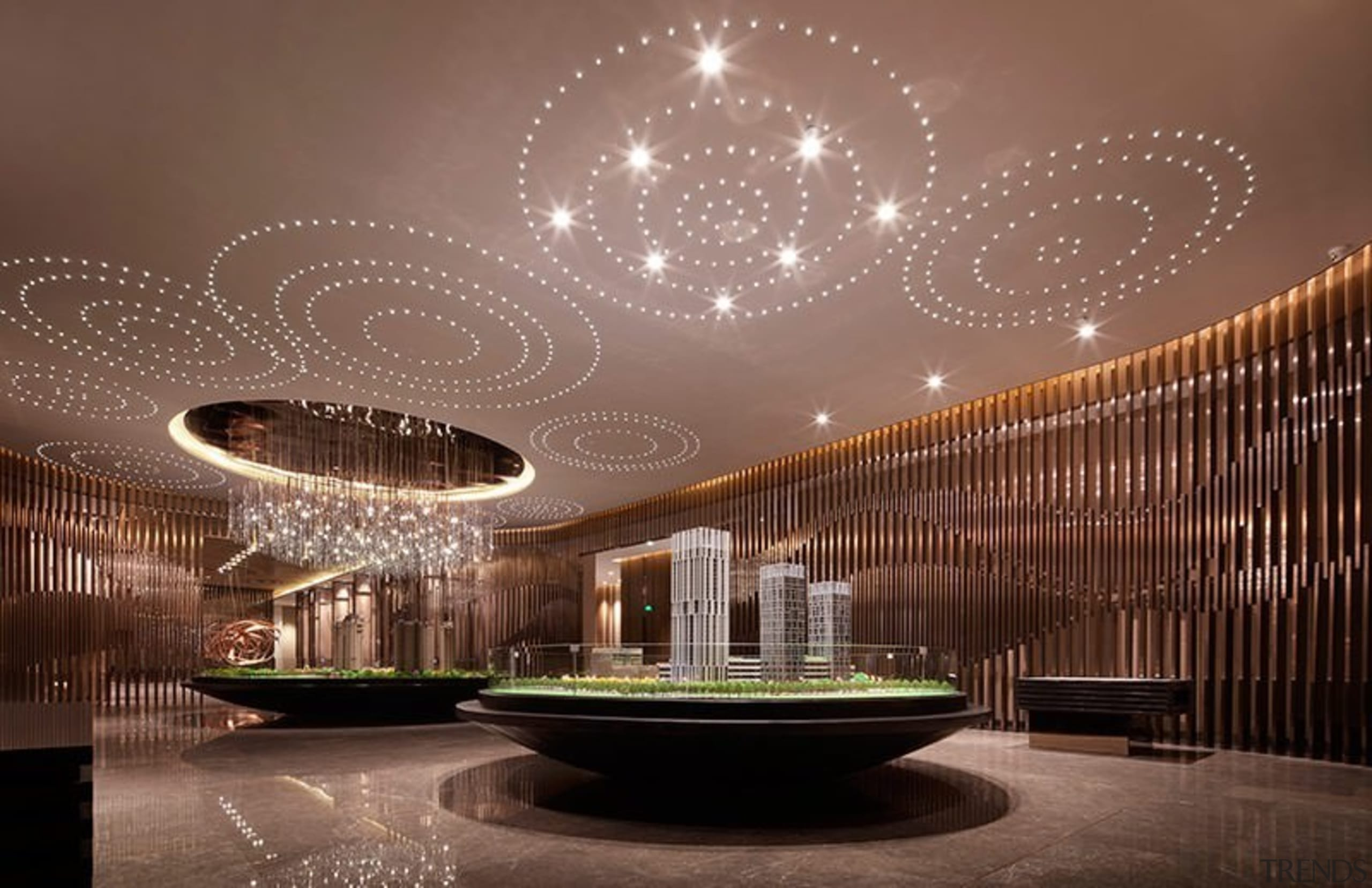 The light patterns in the ceiling resemble water architecture, ceiling, interior design, light fixture, lighting, lobby, brown