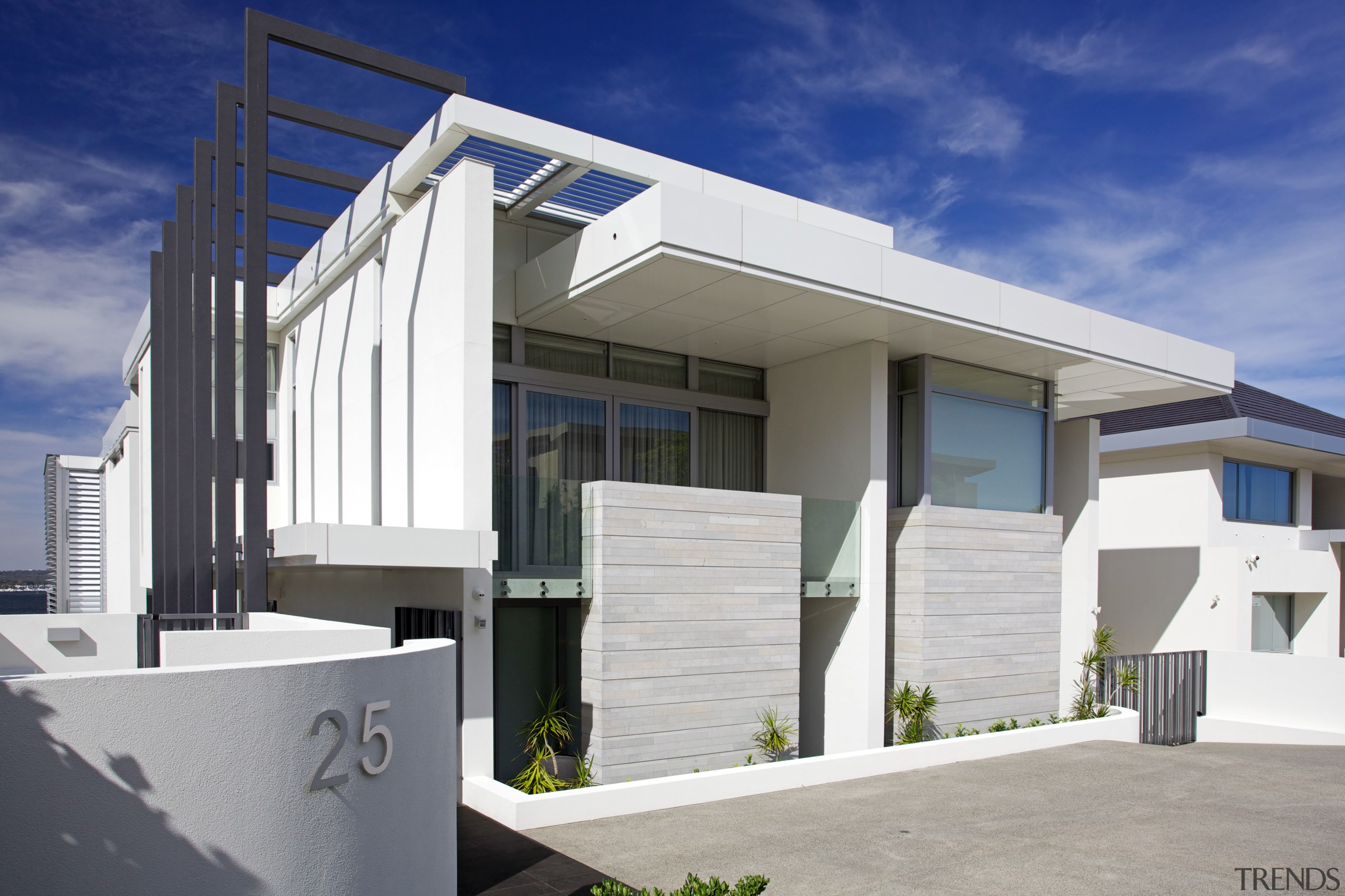 Large ultra modern house on steep site is architecture, building, commercial building, elevation, facade, home, house, property, real estate, residential area, siding, gray, white, blue