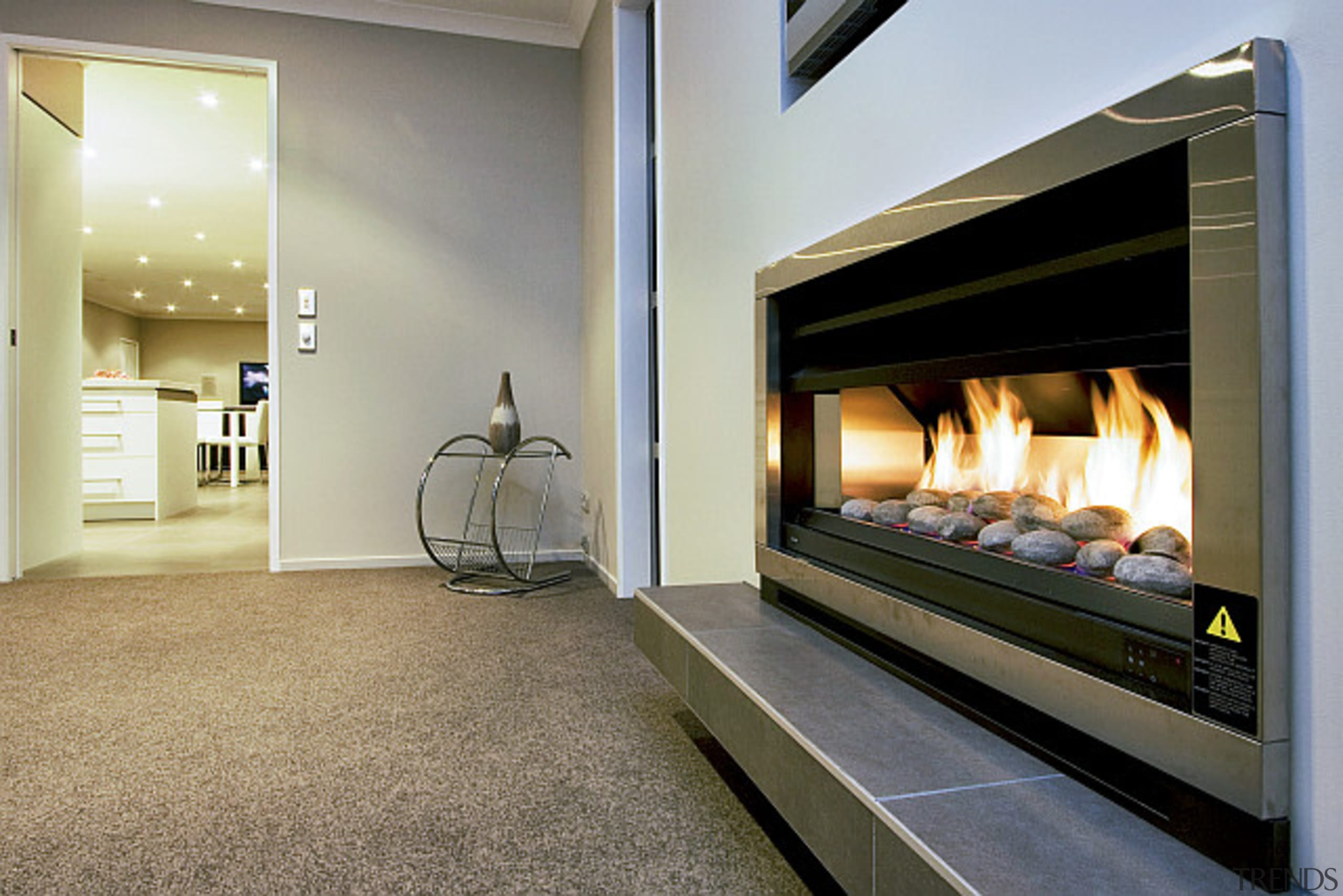 Interior living featuring modern fireplace in a home fireplace, flooring, hearth, home appliance, interior design, gray