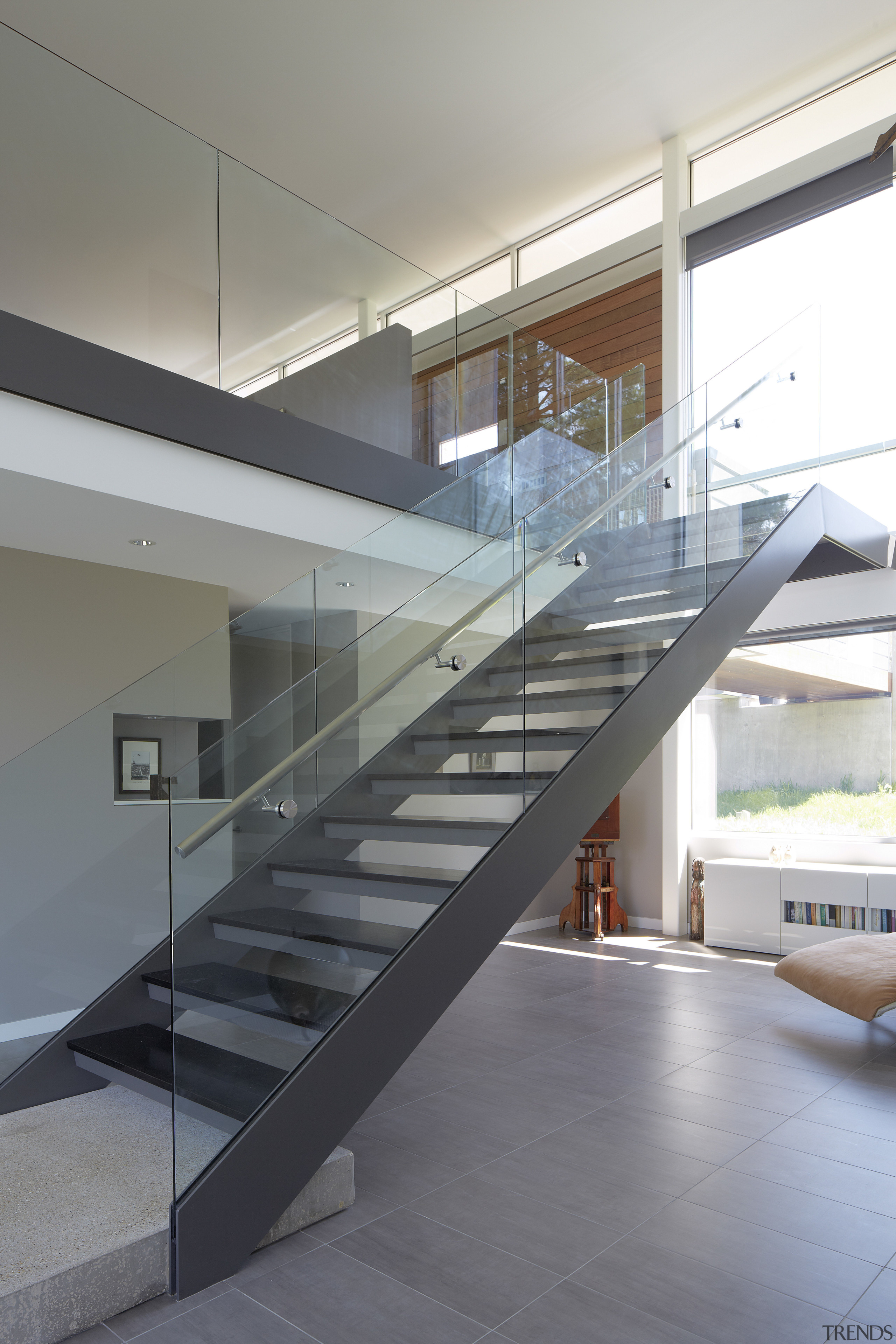 Double height volume in modern riverside home with architecture, daylighting, glass, handrail, house, interior design, stairs, structure, gray