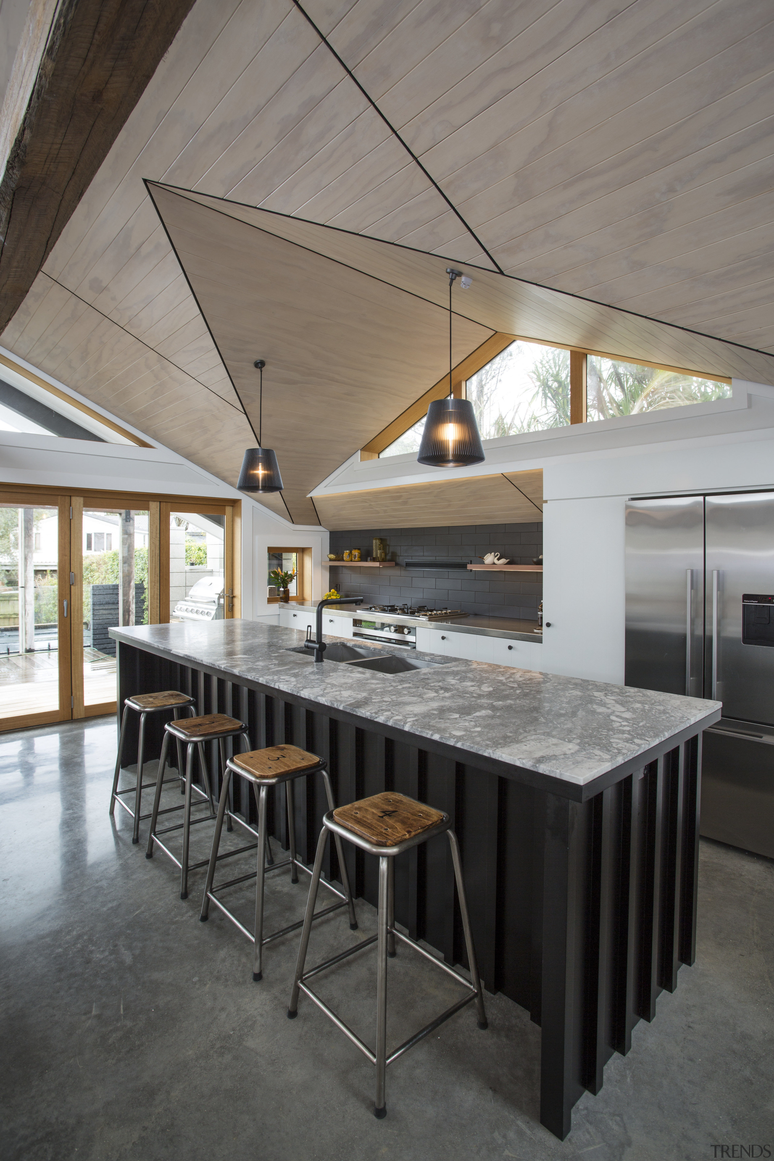 Vertical battens on the front and sides of architecture, beam, ceiling, countertop, floor, flooring, furniture, house, interior design, table, gray, black