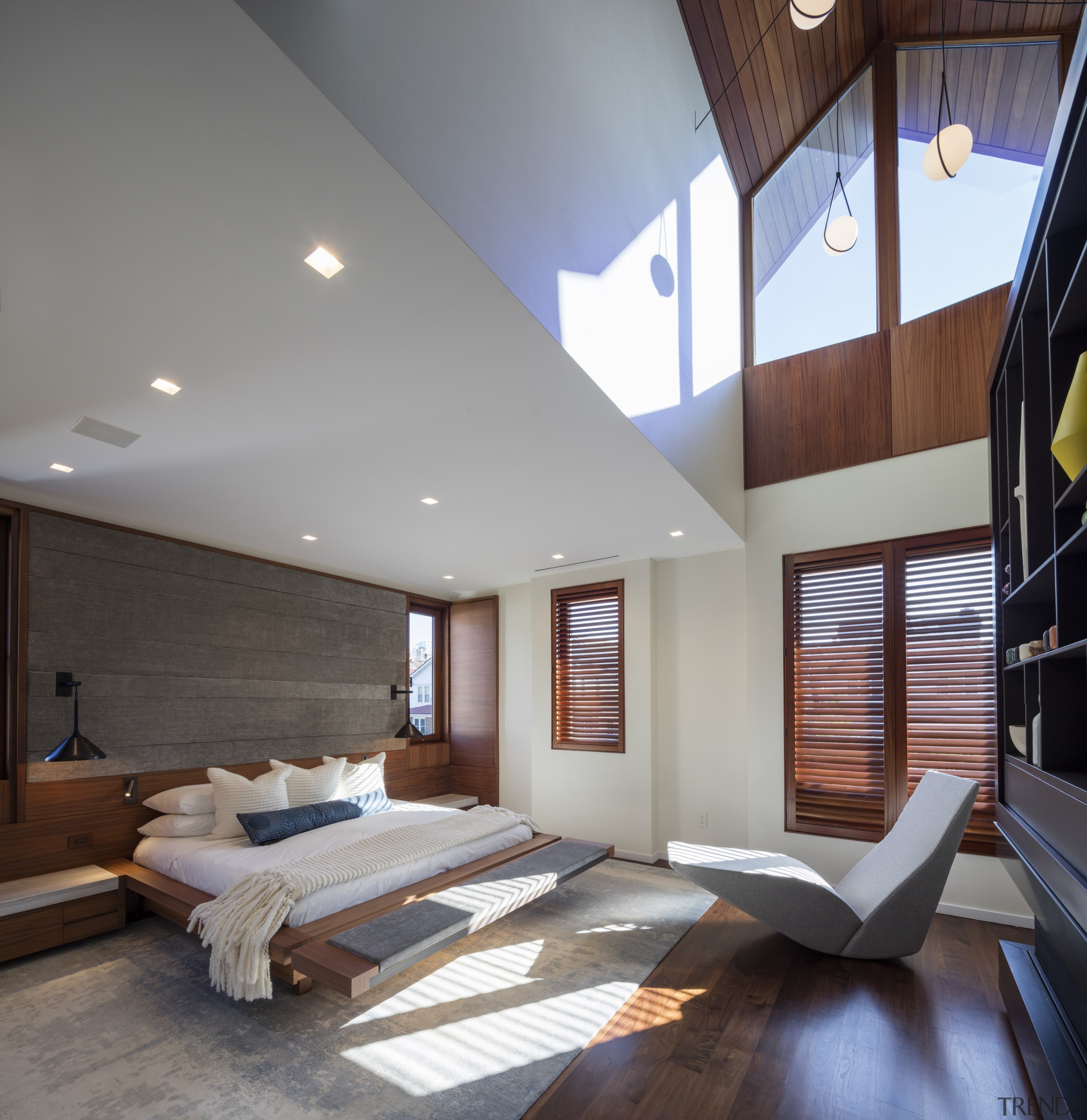 The master bedroom occupies a dynamic volume, while