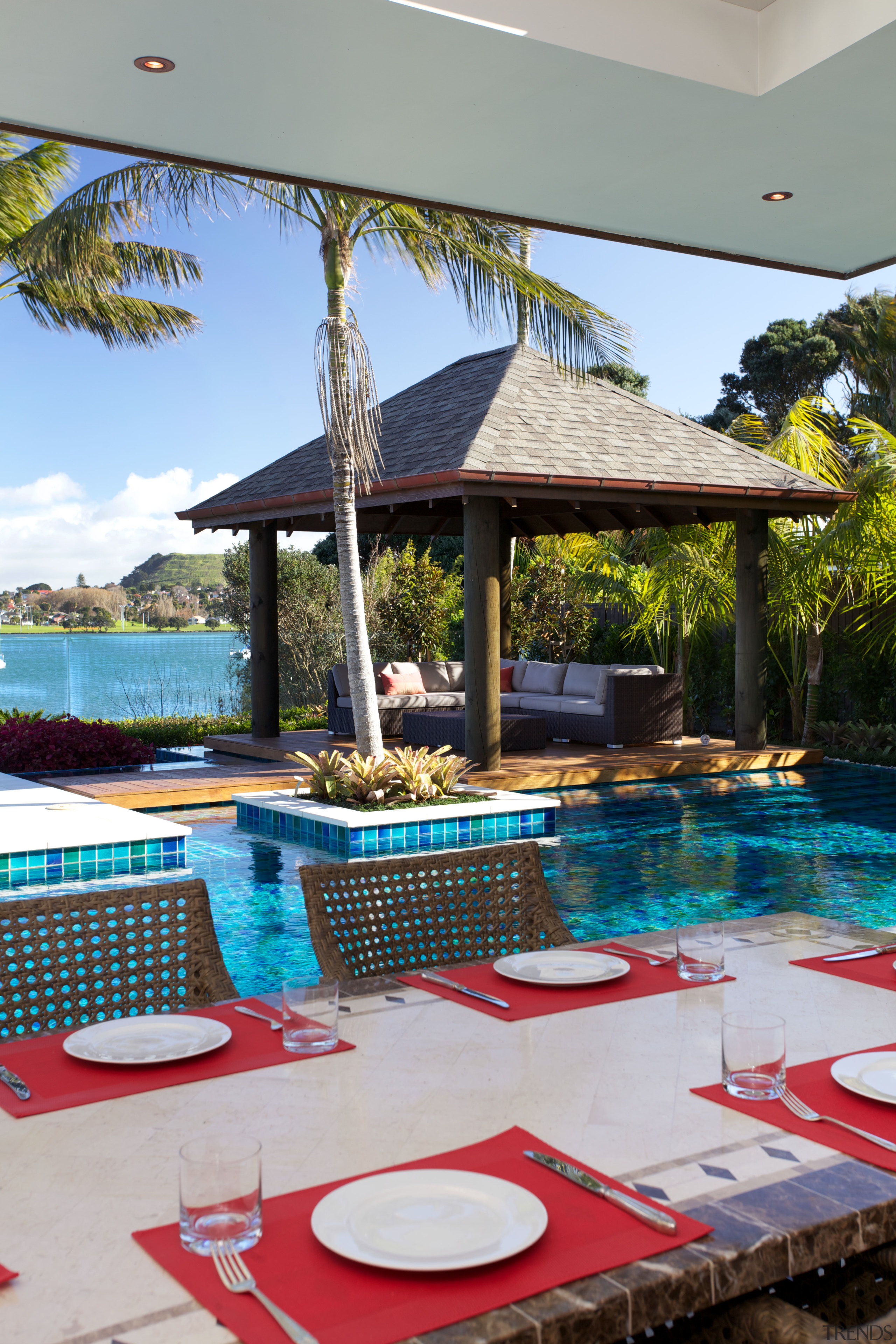 Multi-coloured pool tiles connect to the view and leisure, outdoor structure, property, real estate, resort, swimming pool, table, vacation, villa, gray