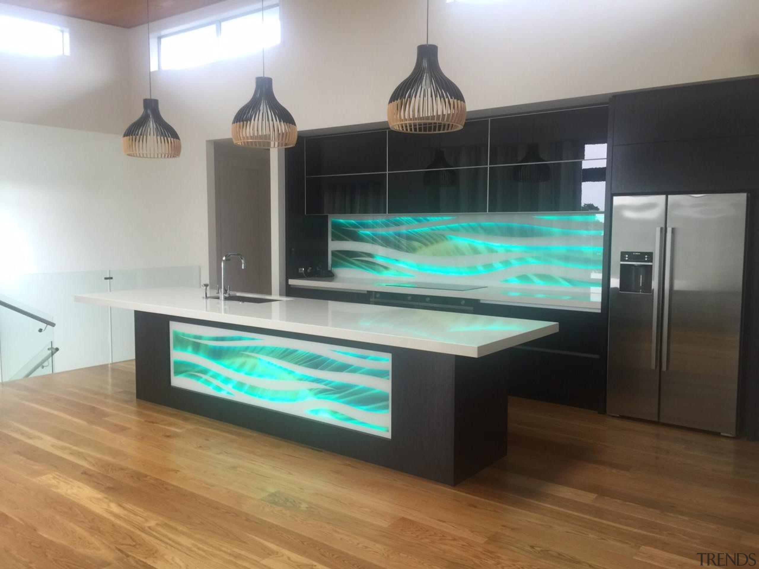 Colourful glass splashbacks create a dynamic backdrop in floor, flooring, furniture, glass, interior design, table, gray, black