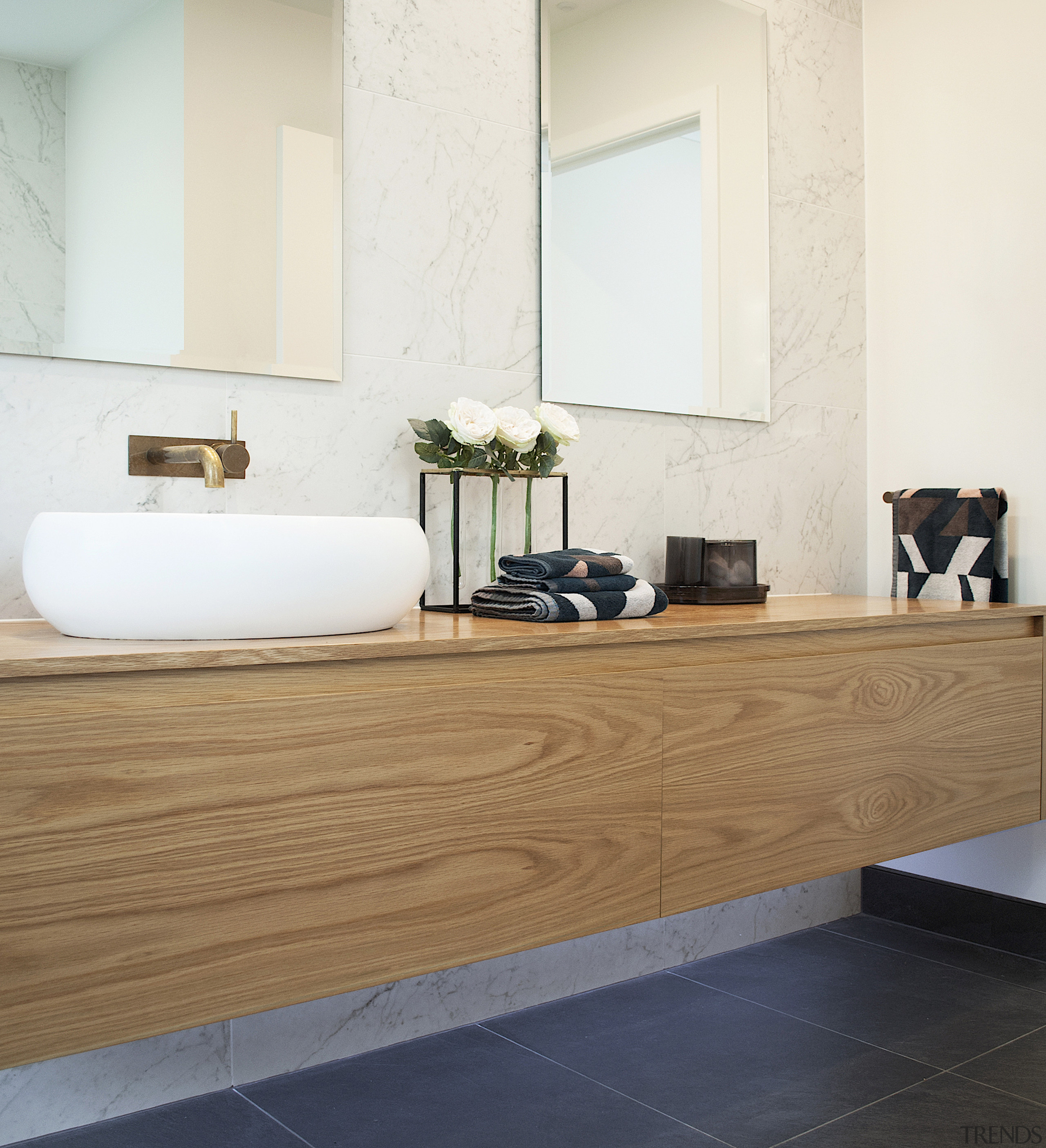 The large vanity creates sufficient storage for the white