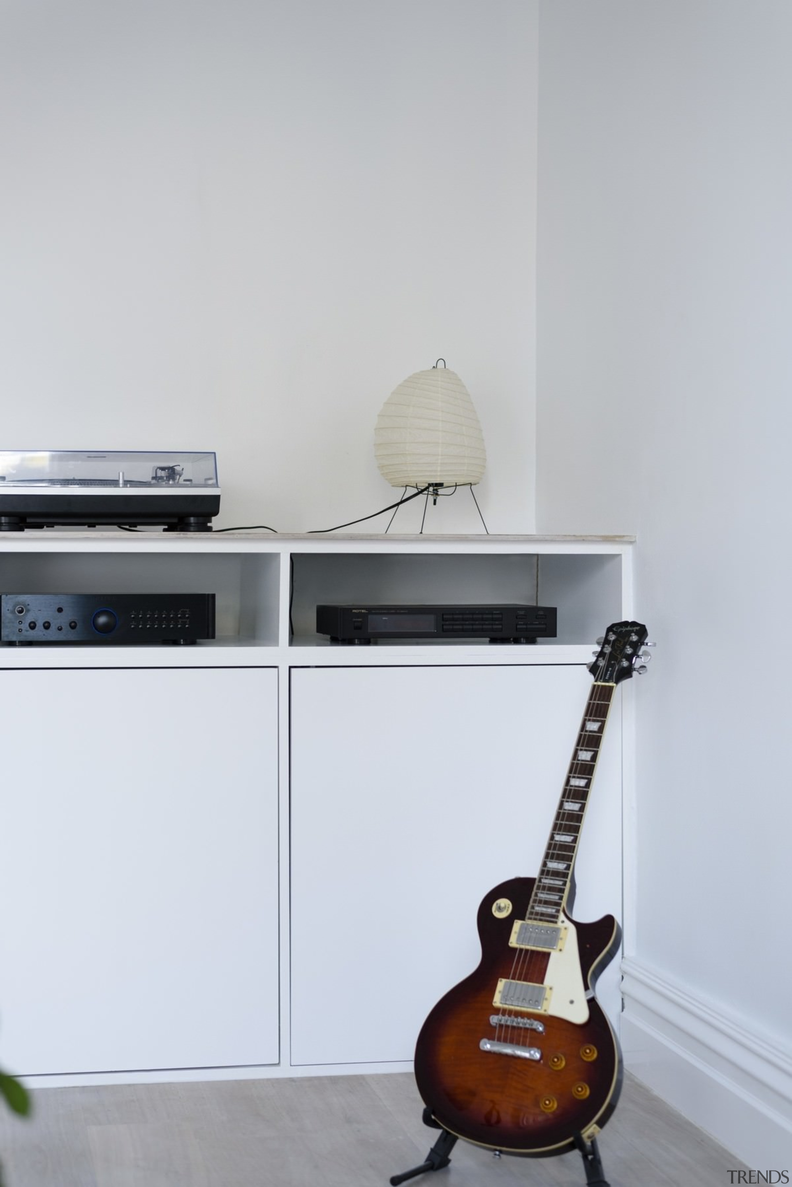 This entertainment centre has space for all the furniture, guitar, musical instrument, musical instrument accessory, plucked string instruments, product design, string instrument, white