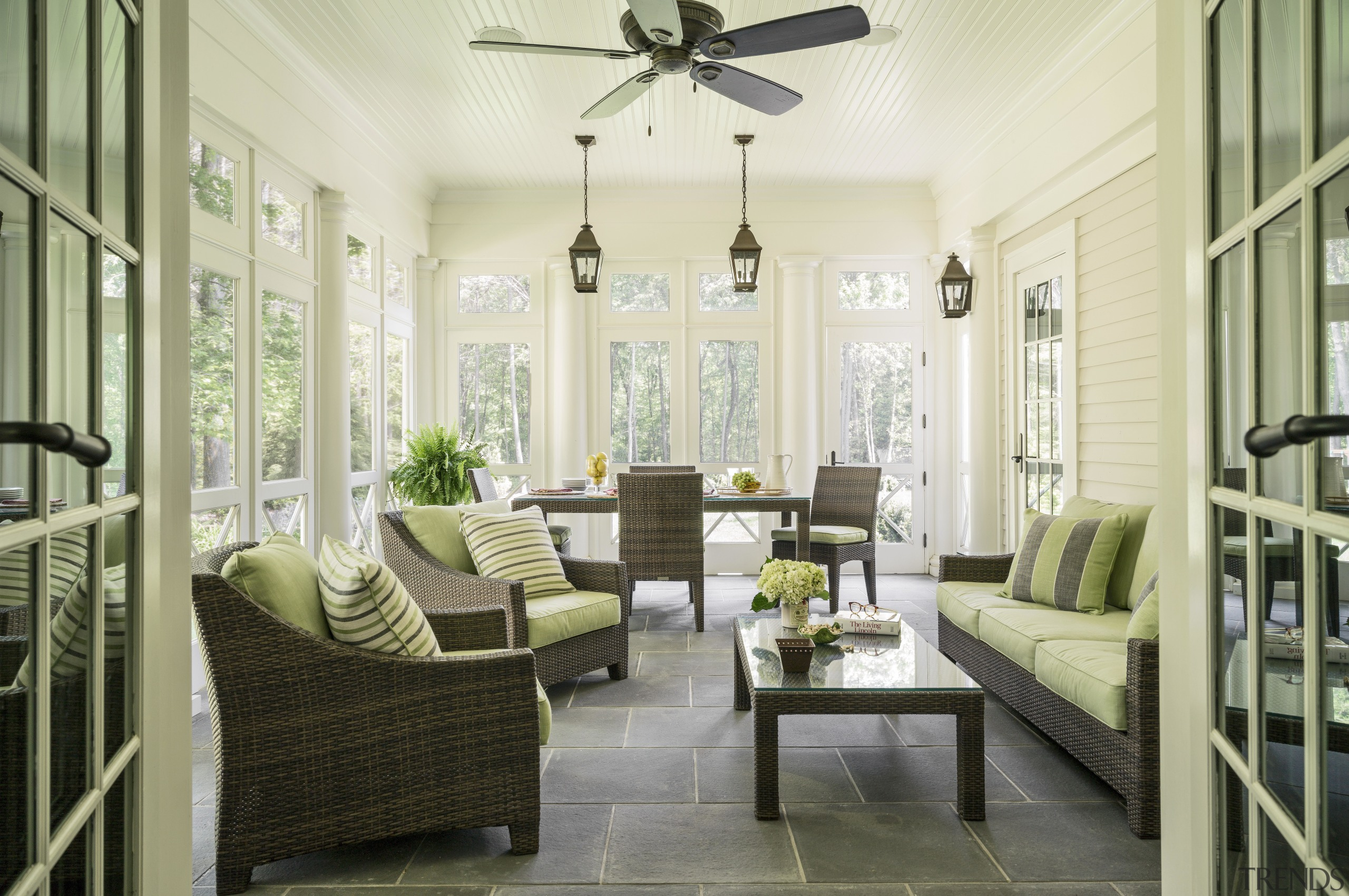 A west-facing screened porch at the rear of ceiling, estate, home, interior design, living room, lobby, porch, real estate, room, window, yellow