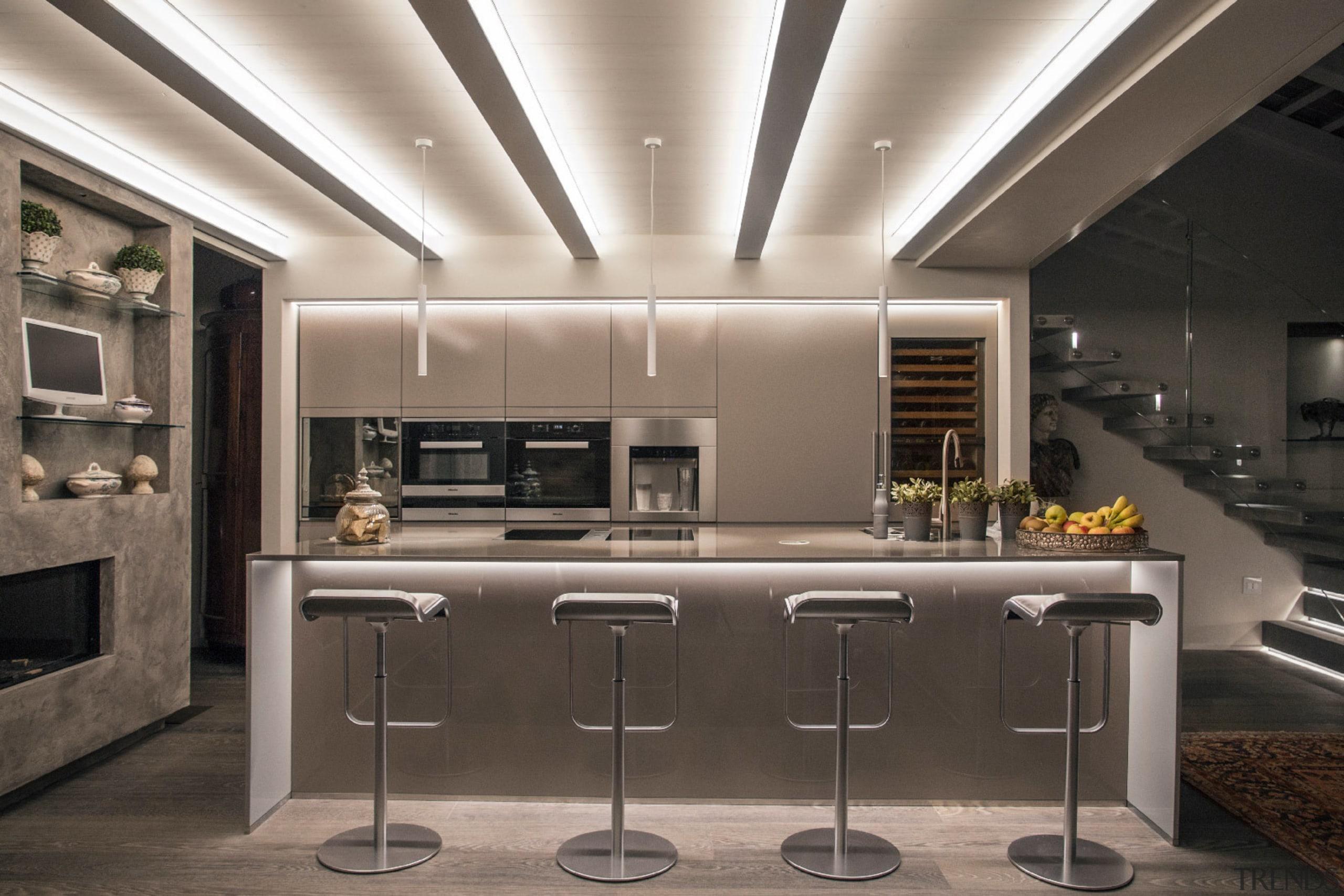A three pendant lighting arrangement is ideally situated countertop, cuisine classique, interior design, kitchen, gray, black