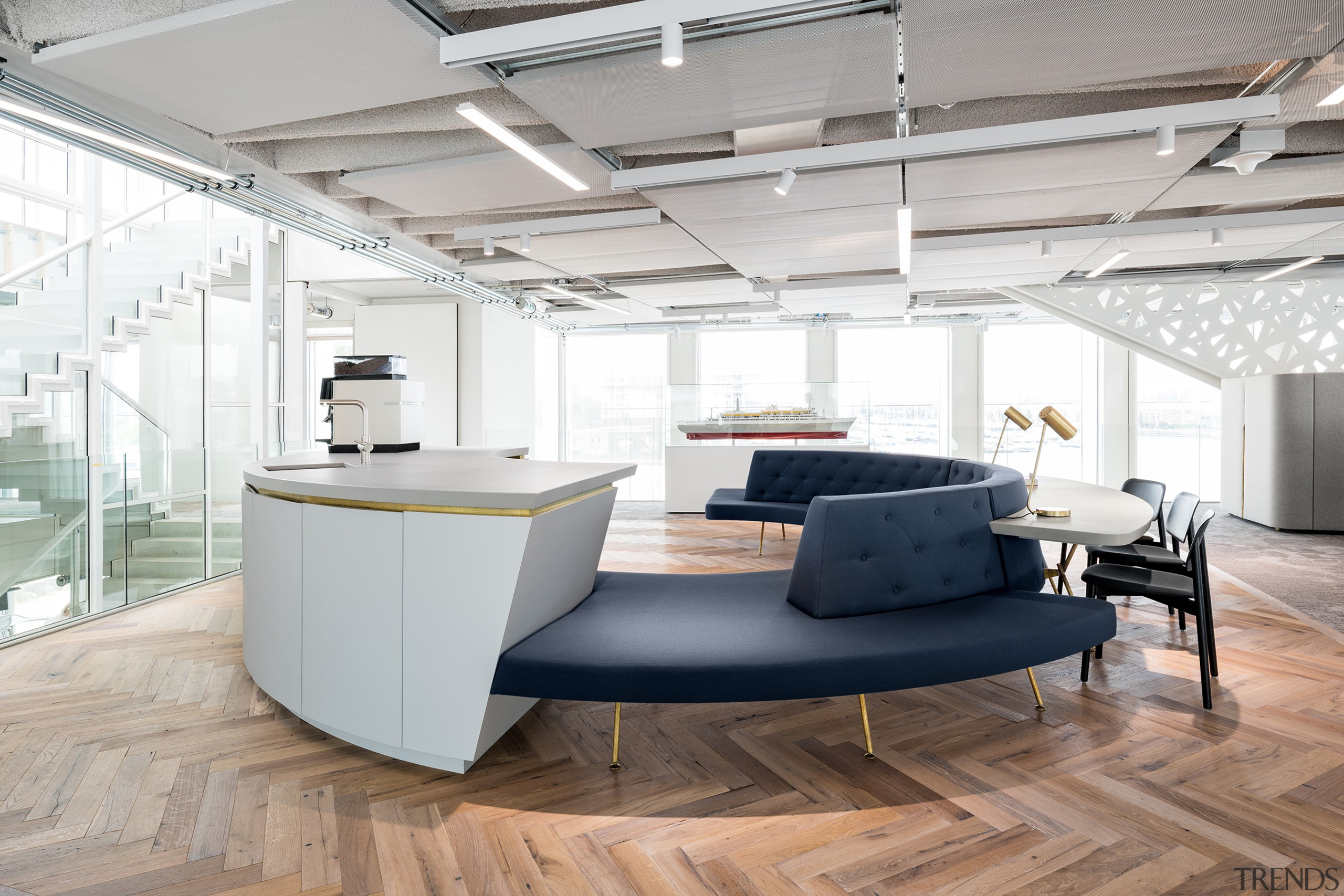 Rounded greeting – the circular reception area visitors architecture, building, ceiling, design, desk, floor, flooring, furniture, house, interior design, laminate flooring, loft, material property, office, office chair, property, room, space, table, wall, wood flooring, white