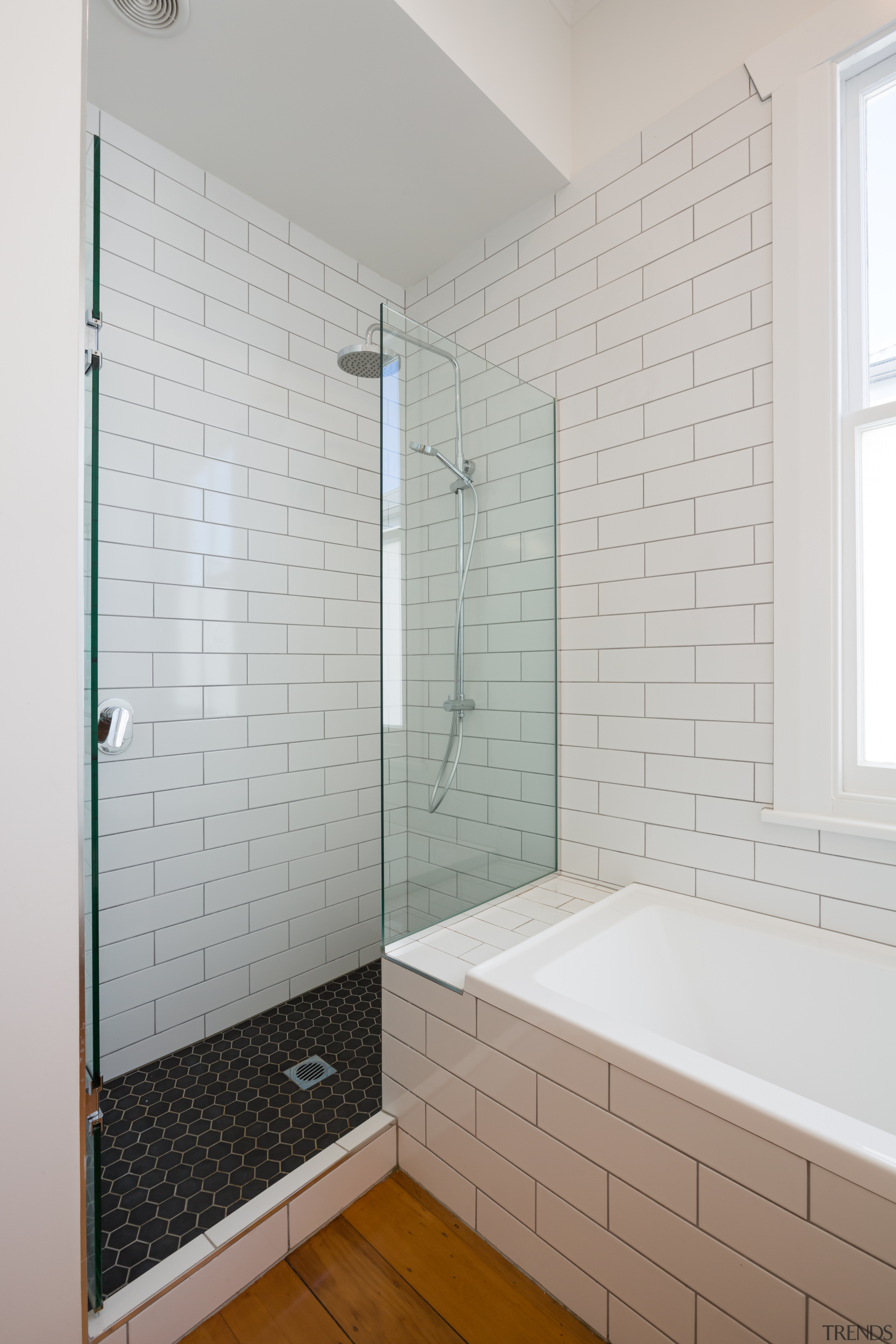 ​​​​​​​Now and then – on this future-proofed bathroom, bathroom, timber floor, shower, glass,  plumbing fixtures, subway tiles, Chris Holmes, CAAAHT Studio Architects