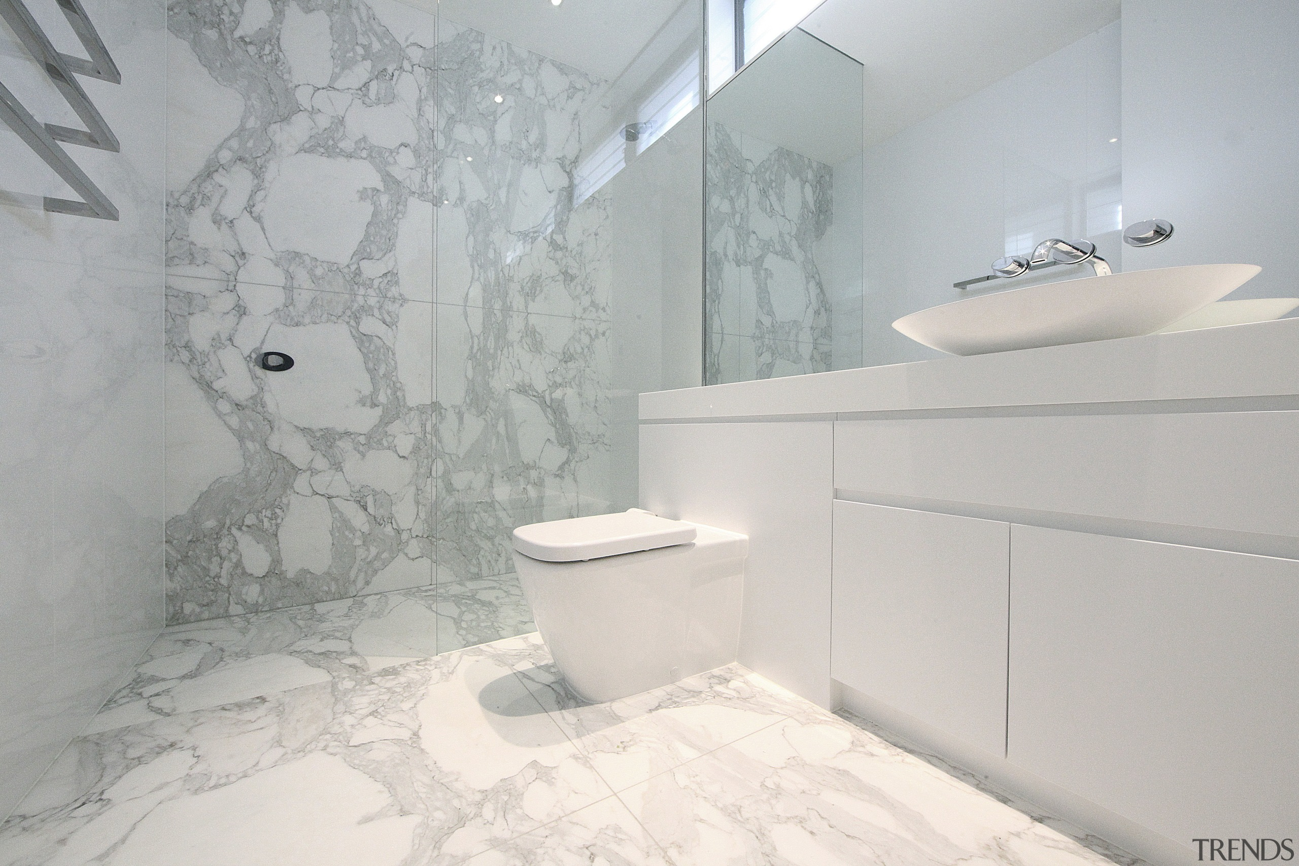 Bathroom with white vanity and toilet and marble bathroom, bidet, ceramic, floor, home, interior design, plumbing fixture, product design, property, room, tap, tile, toilet seat, wall, gray, white