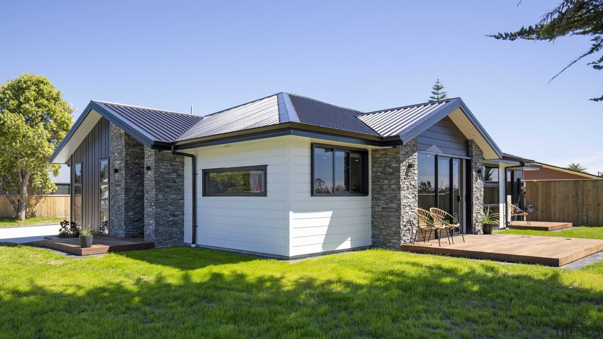 Low-upkeep Linea weatherboard is matched with schist accents