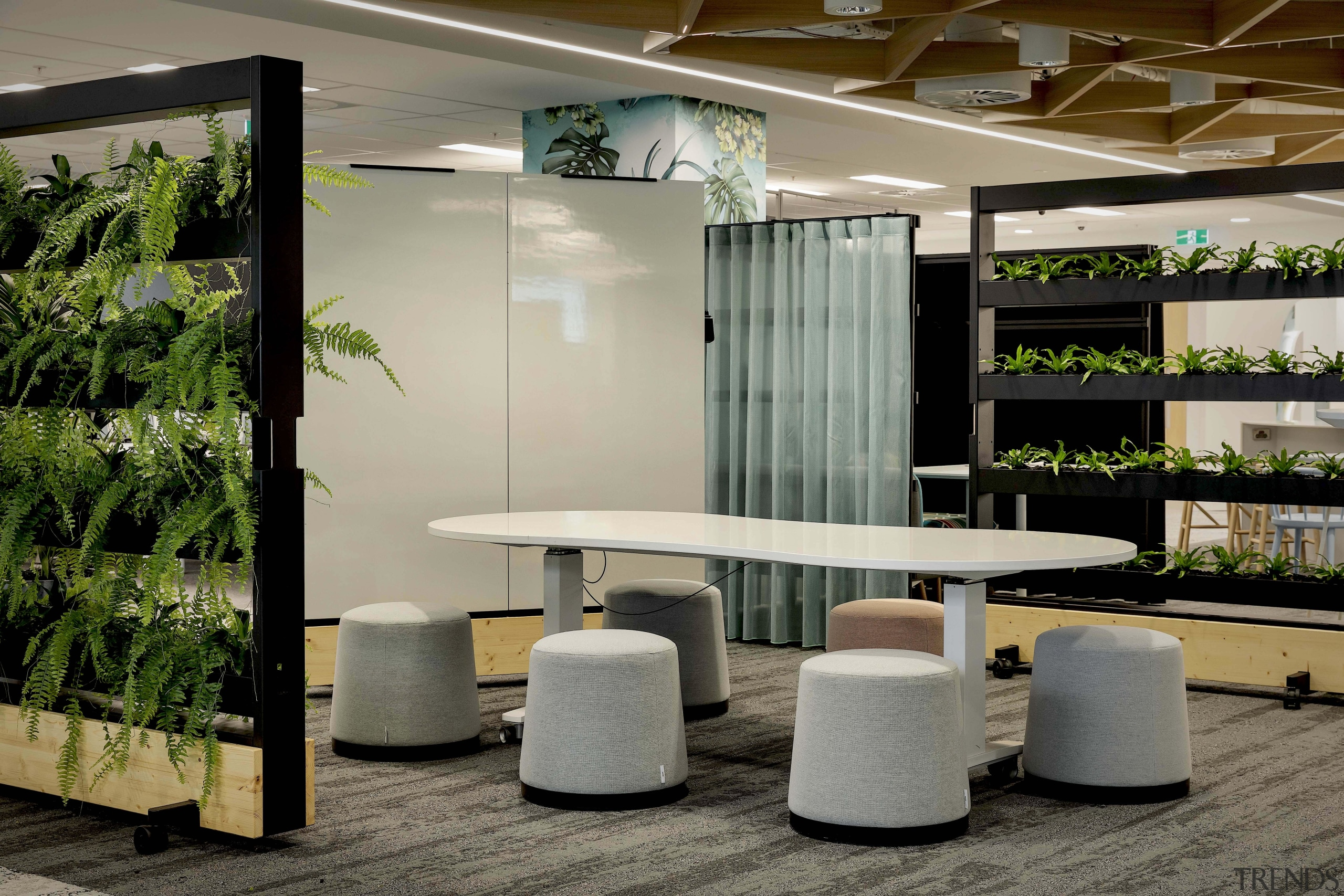 This flexible, relaxing collaboration space benefits from an gray