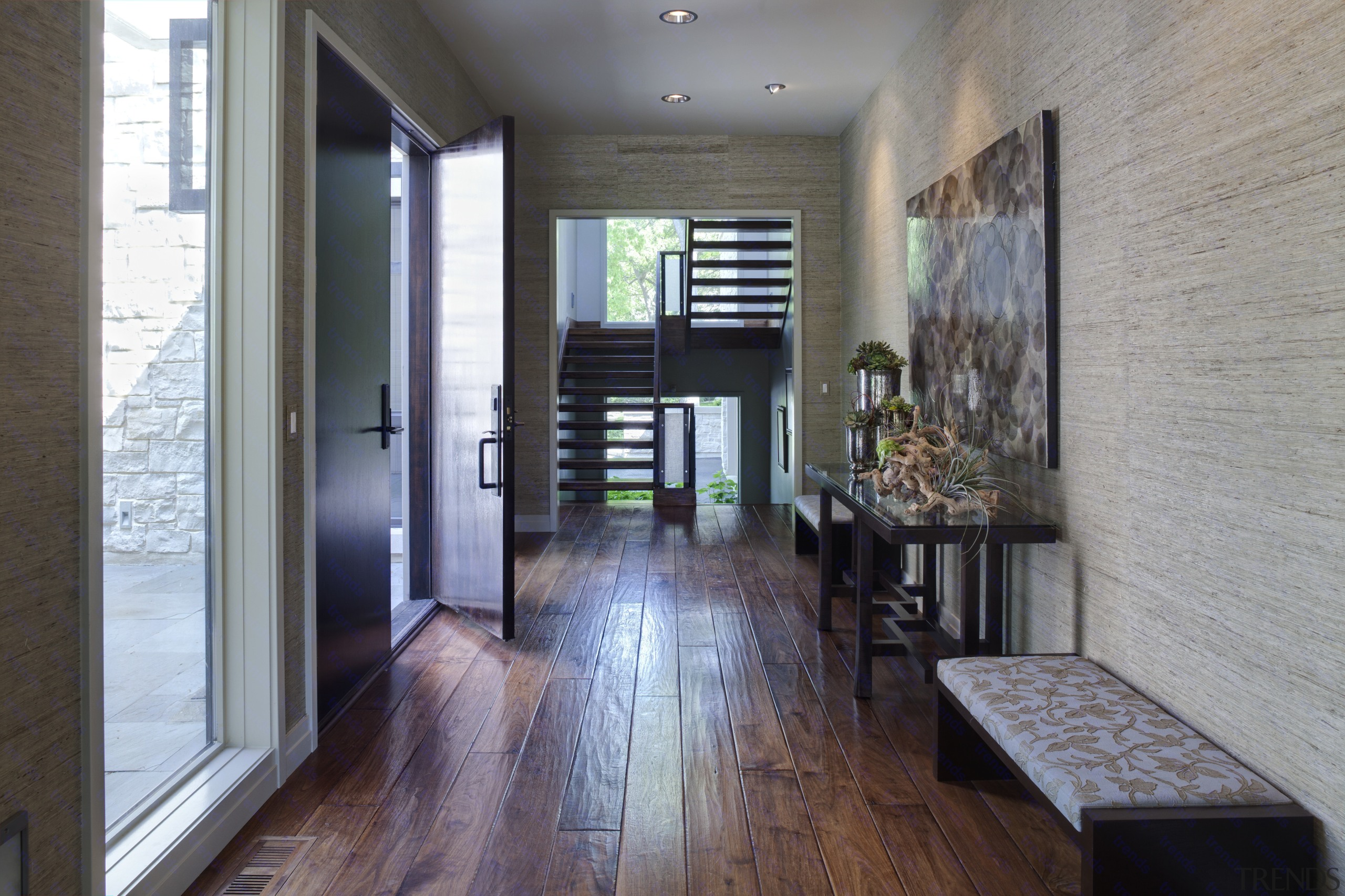 Greys and whites offset wooden floors and ceilings. floor, flooring, hardwood, house, interior design, wood, wood flooring, gray, black