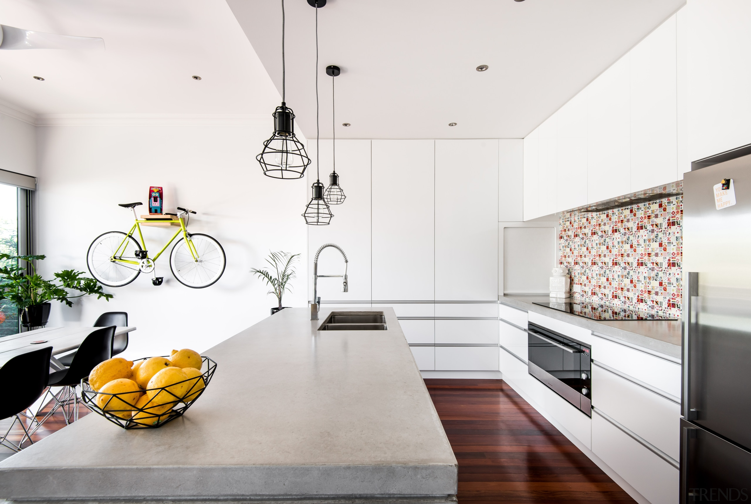 By combining carefully placed additions with a clever architecture, building, cabinetry, ceiling, countertop, design, floor, flooring, furniture, home, house, interior design, kitchen, light fixture, loft, material property, property, room, table, tile, wall, white, wood flooring, yellow, white