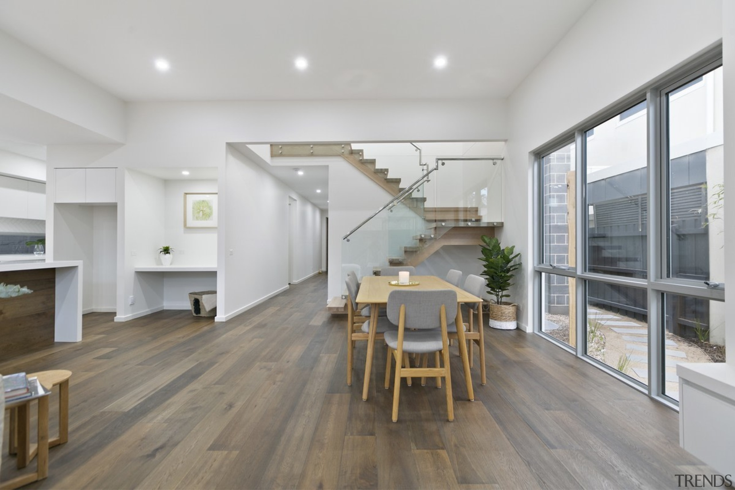 The wood floors run the length of the architecture, floor, flooring, house, interior design, real estate, wood flooring, gray