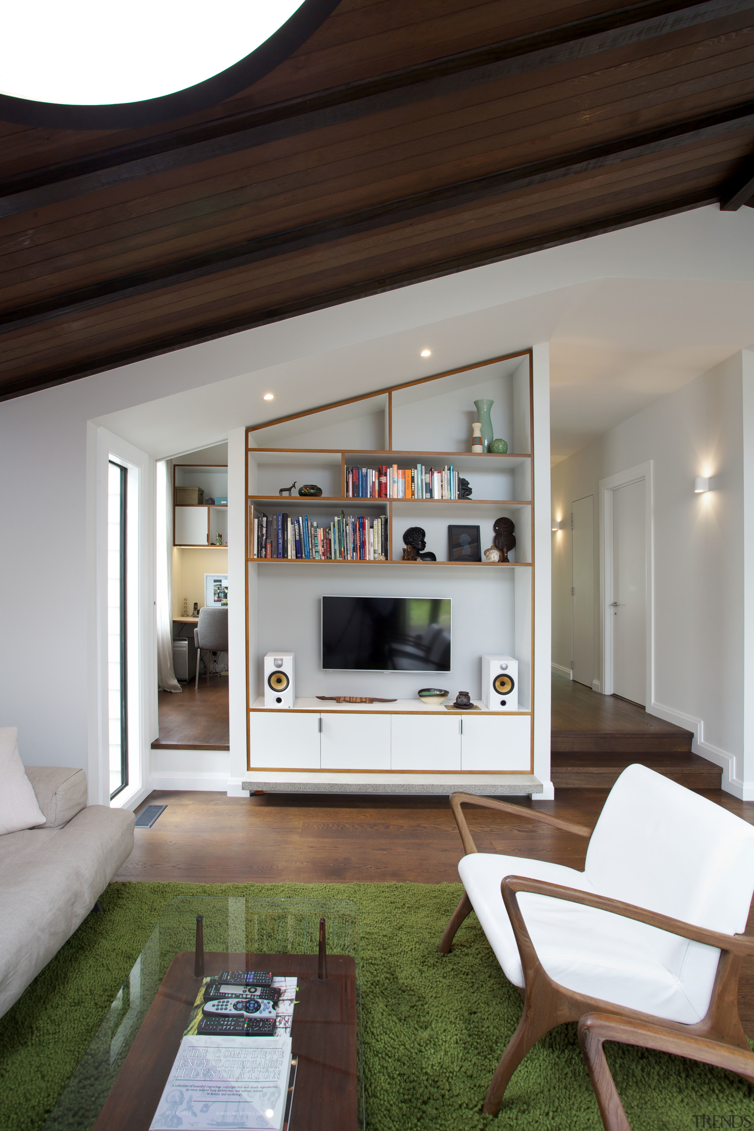 In this renovated villa, a home office is furniture, home, house, interior design, living room, table, black, white