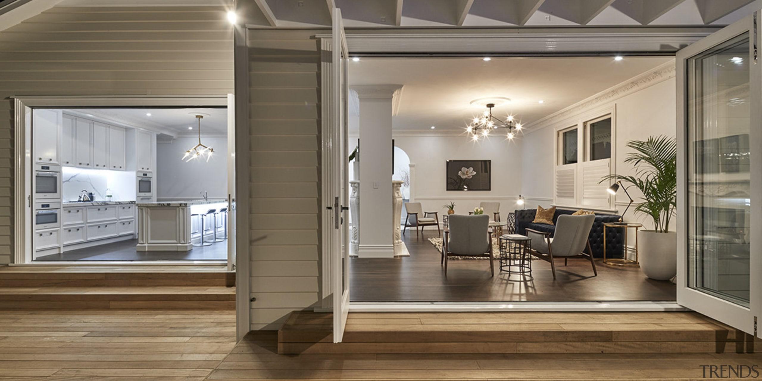 This villa renovation has reworked the organisation of ceiling, floor, flooring, interior design, laminate flooring, living room, window, wood flooring, gray, brown