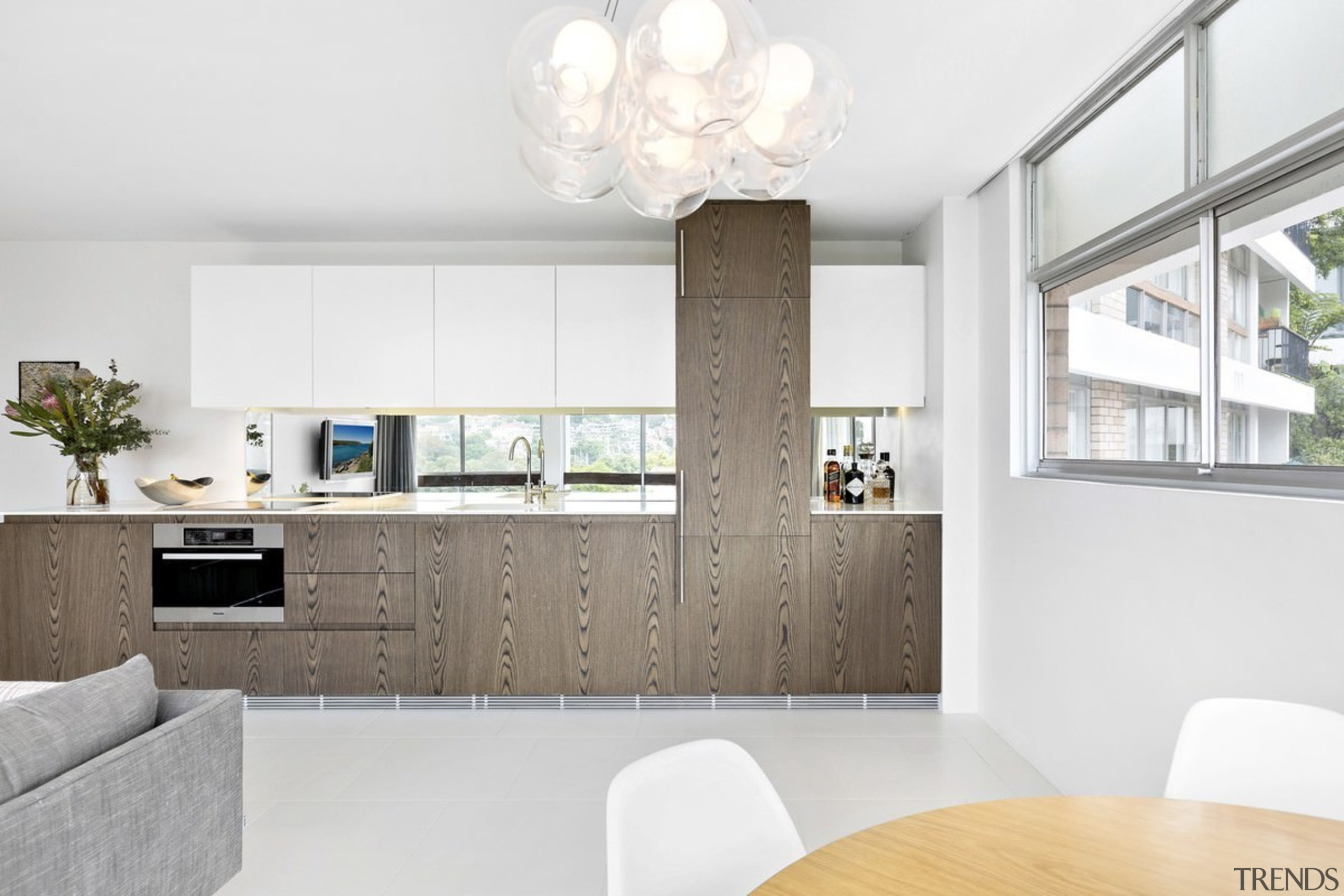 Wood panels on these cabinets break up the architecture, home, interior design, interior designer, living room, product design, white
