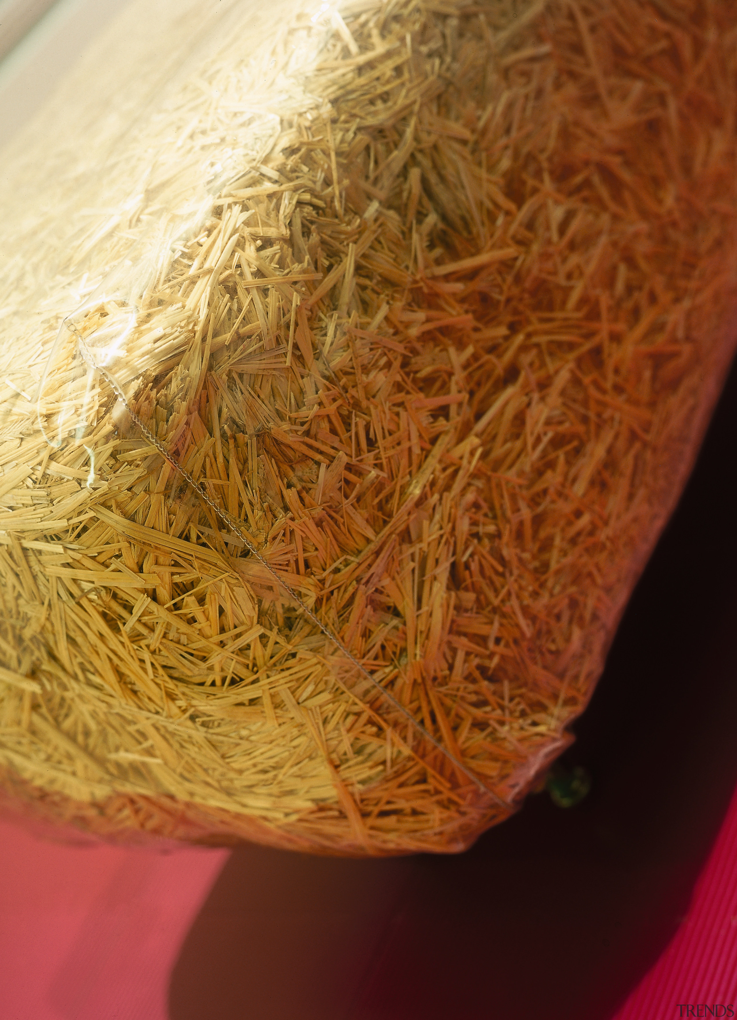 A close up view of the stools. - straw, brown