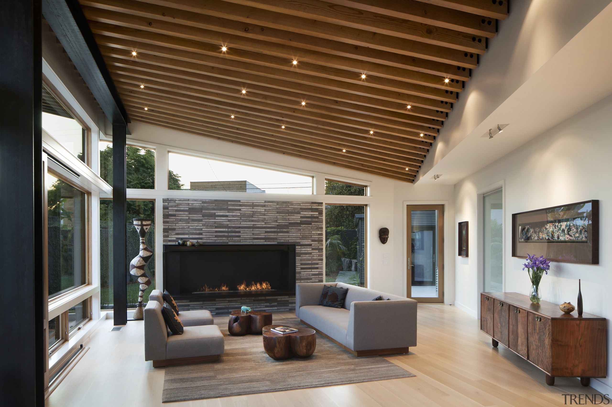 The living pavilion itself is constructed with wood, architecture, ceiling, daylighting, house, interior design, living room, real estate, brown, gray