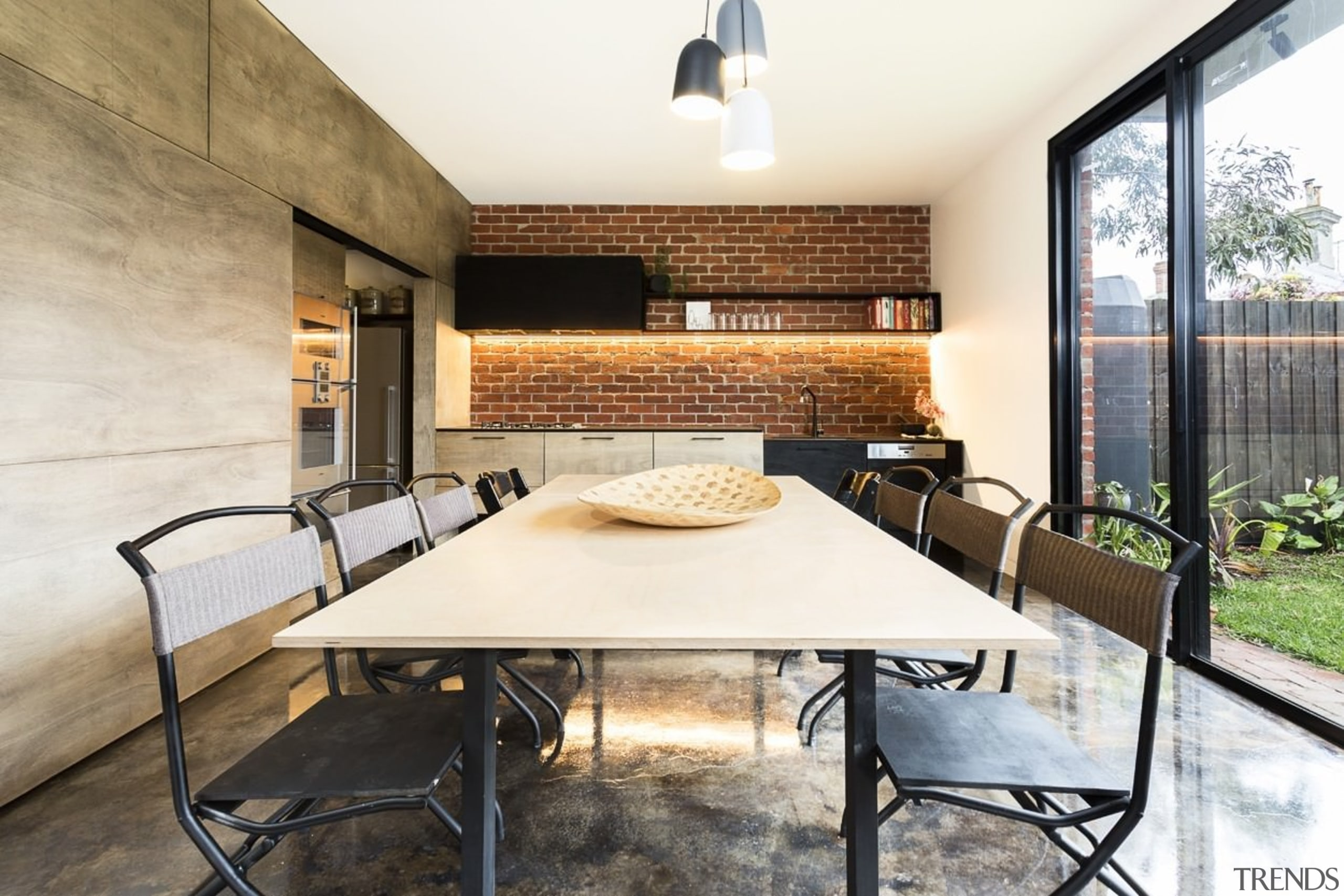 A dining/kitchen area opens out to the backyard architecture, house, interior design, real estate, table, white